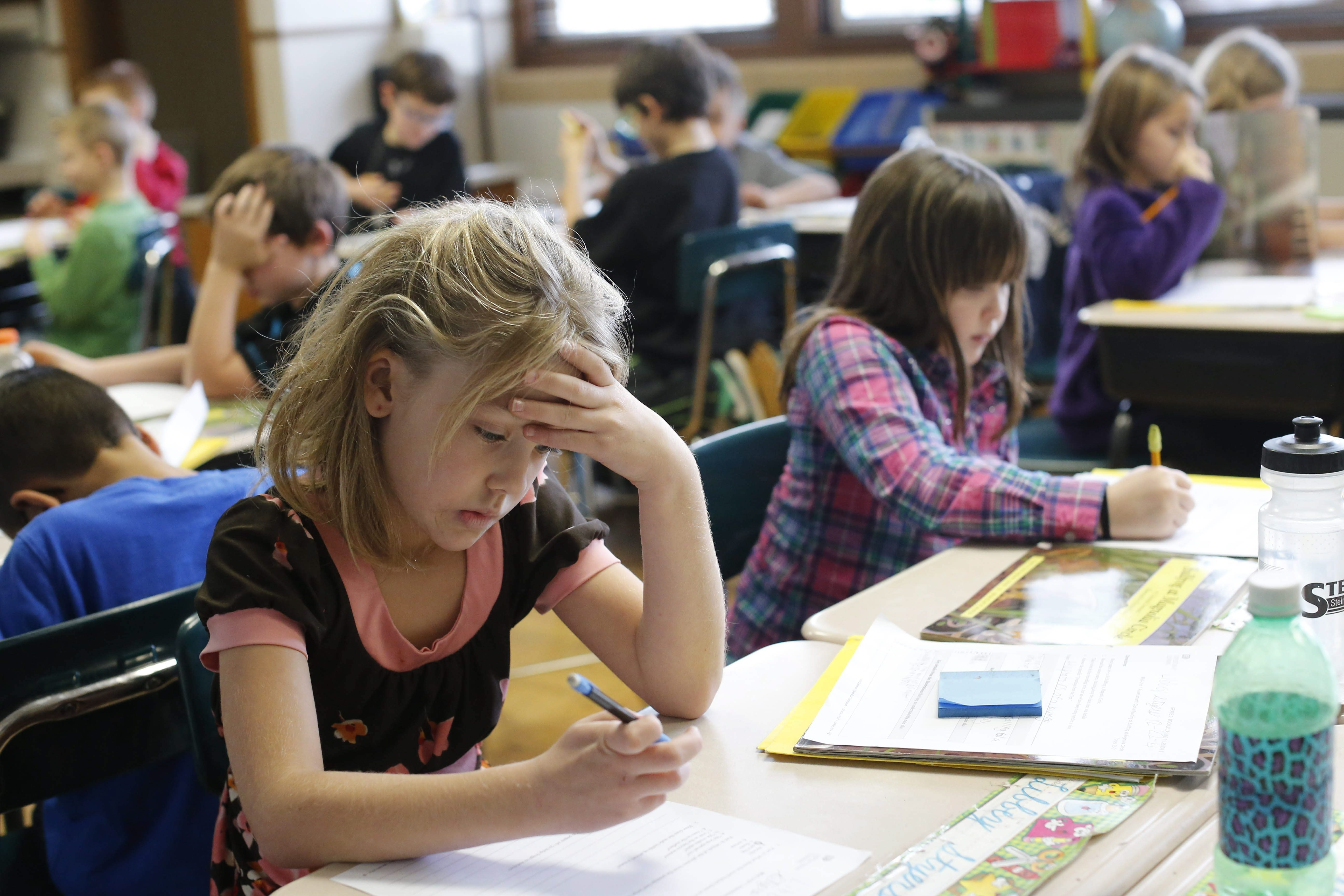 Third-grader Libby Stryers concentrates as she answers test questions at Eden Elementary School.