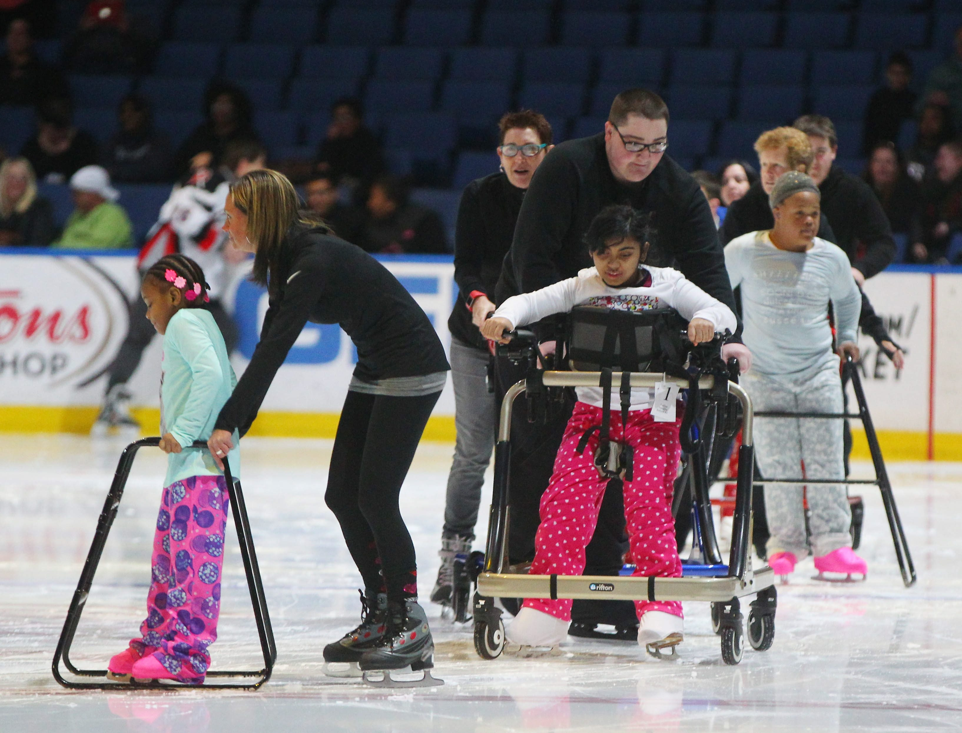 Participants and volunteers from School 84 and St. Mary's Lockport perform Sunday during SABAH's Celebration on Ice at the First Niagara Center. See a photo gallery at BuffaloNews.com.