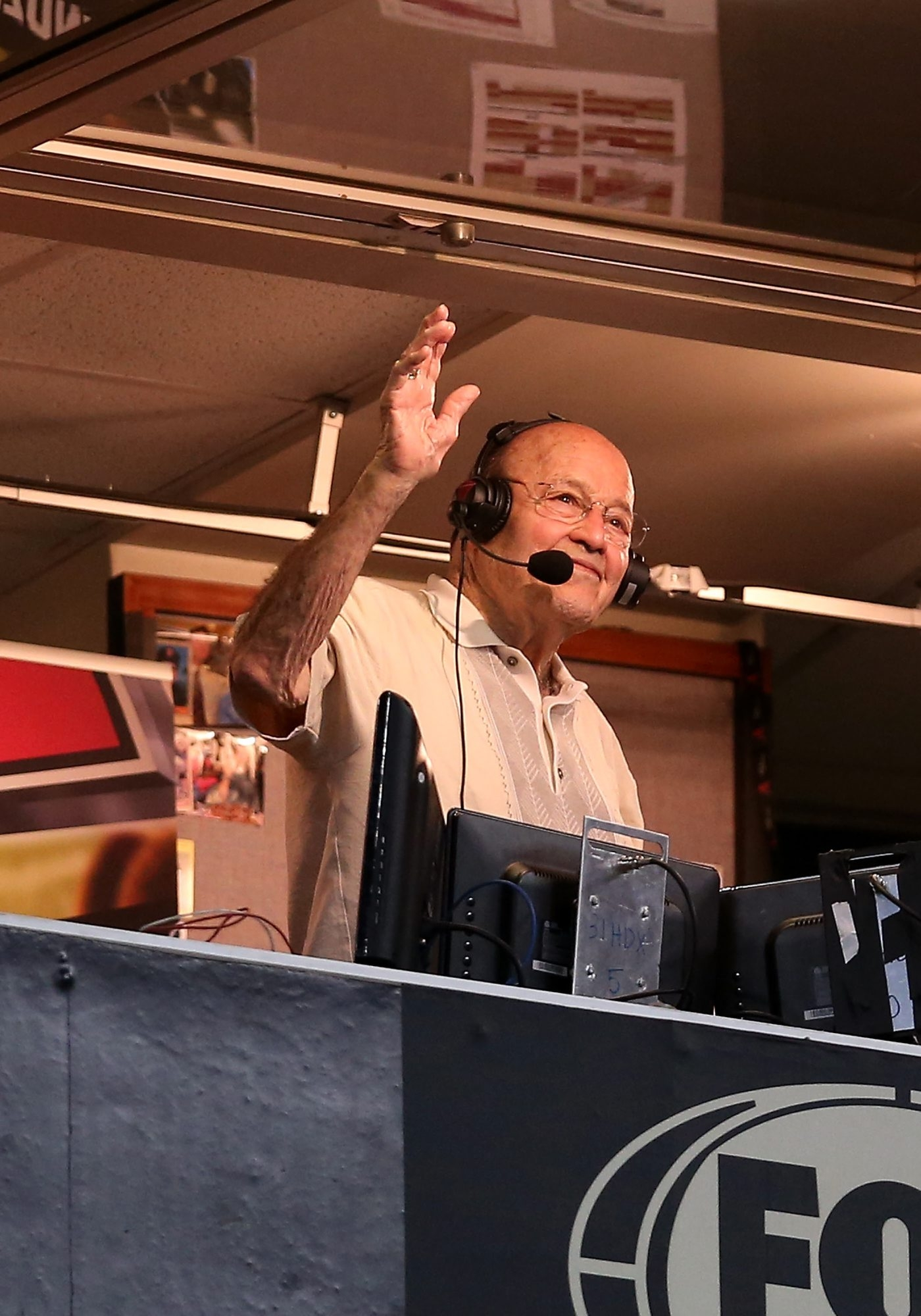 Broadcaster Joe Garagiola, who died March 23, waves to fans upon his retirement in 2013 in Phoenix.