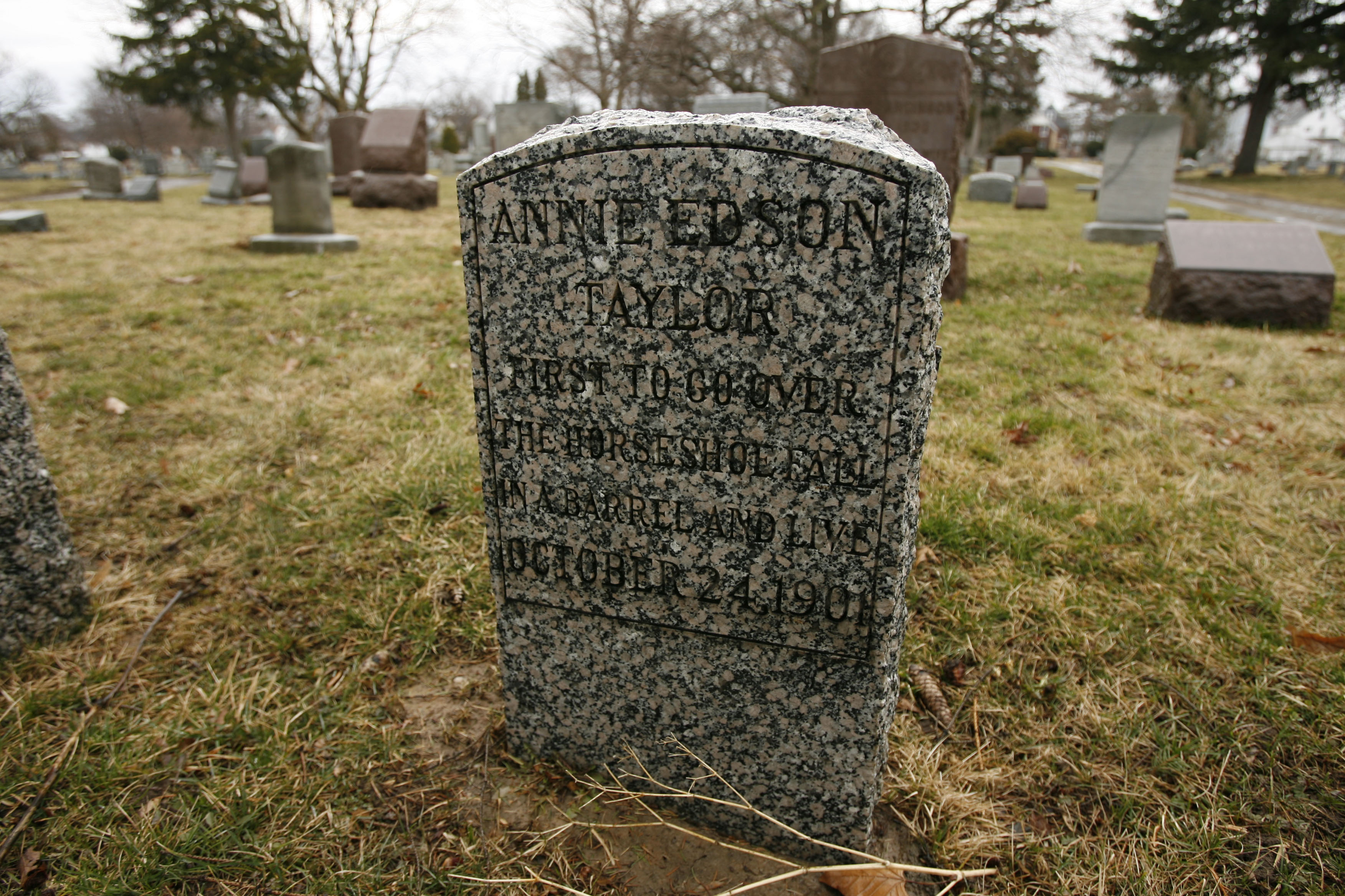 The tombstone of Annie Edson Taylor, the first person to survive going over Niagara Falls in a barrel, in Oakwood Cemetery in Niagara Falls.  (News file photo)