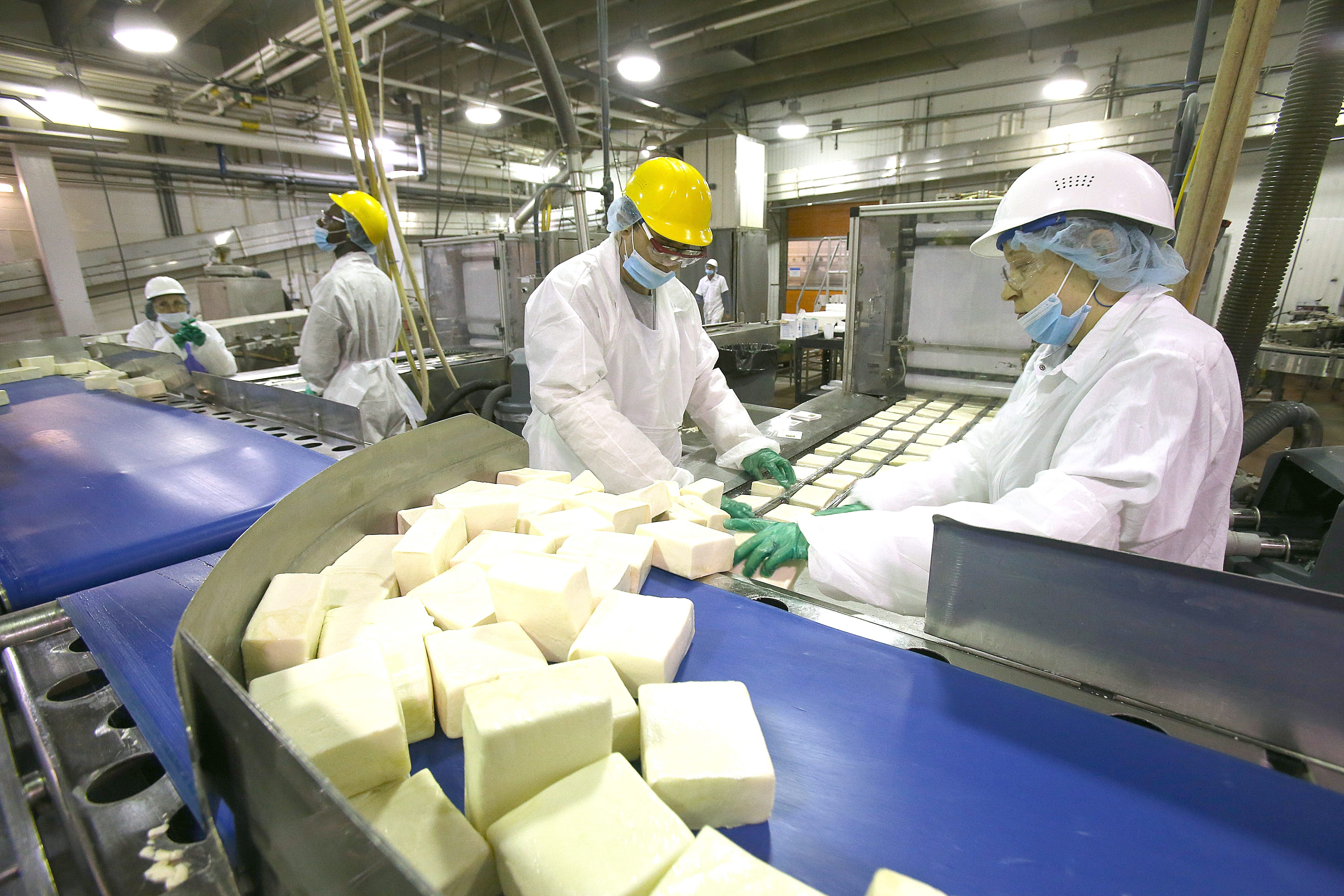 Sorrento employees load fresh blocks of mozzerella  at the South Park Avenue plant. (New file photo)