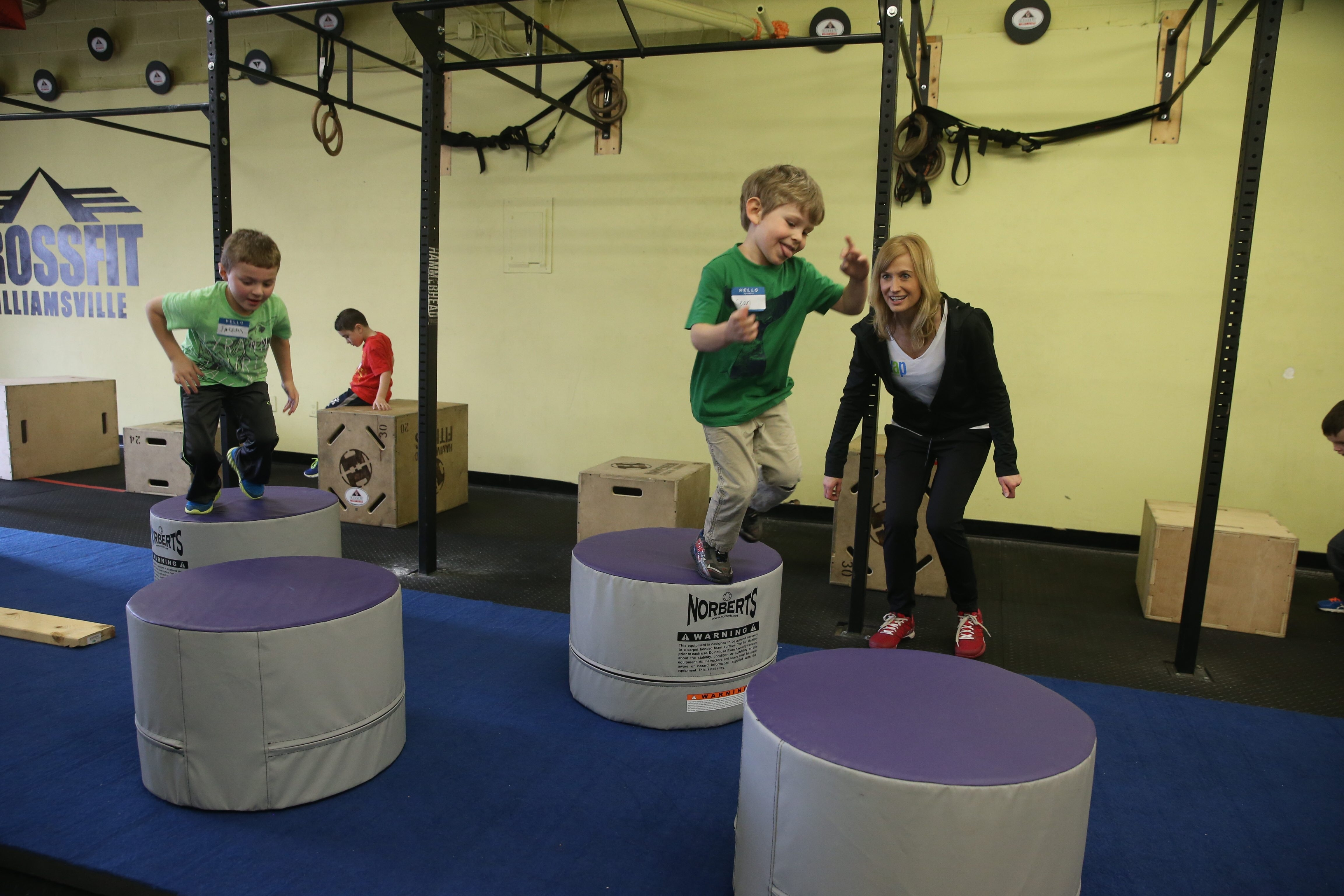 Centerspread for next Saturday's Refresh on getting kids fit to get the most out of the outdoors in the coming months, Christina Bleckinger and her company, SWAP (School Wellness Awareness Project), go to schools and, in this case, a birthday party, set up obstacle course, give kids healthy food and talk to them about health and fitness at the CrossFit, in Williamsville,  N.Y., on Saturday, April 2, 2016. (John Hickey/Buffalo News)