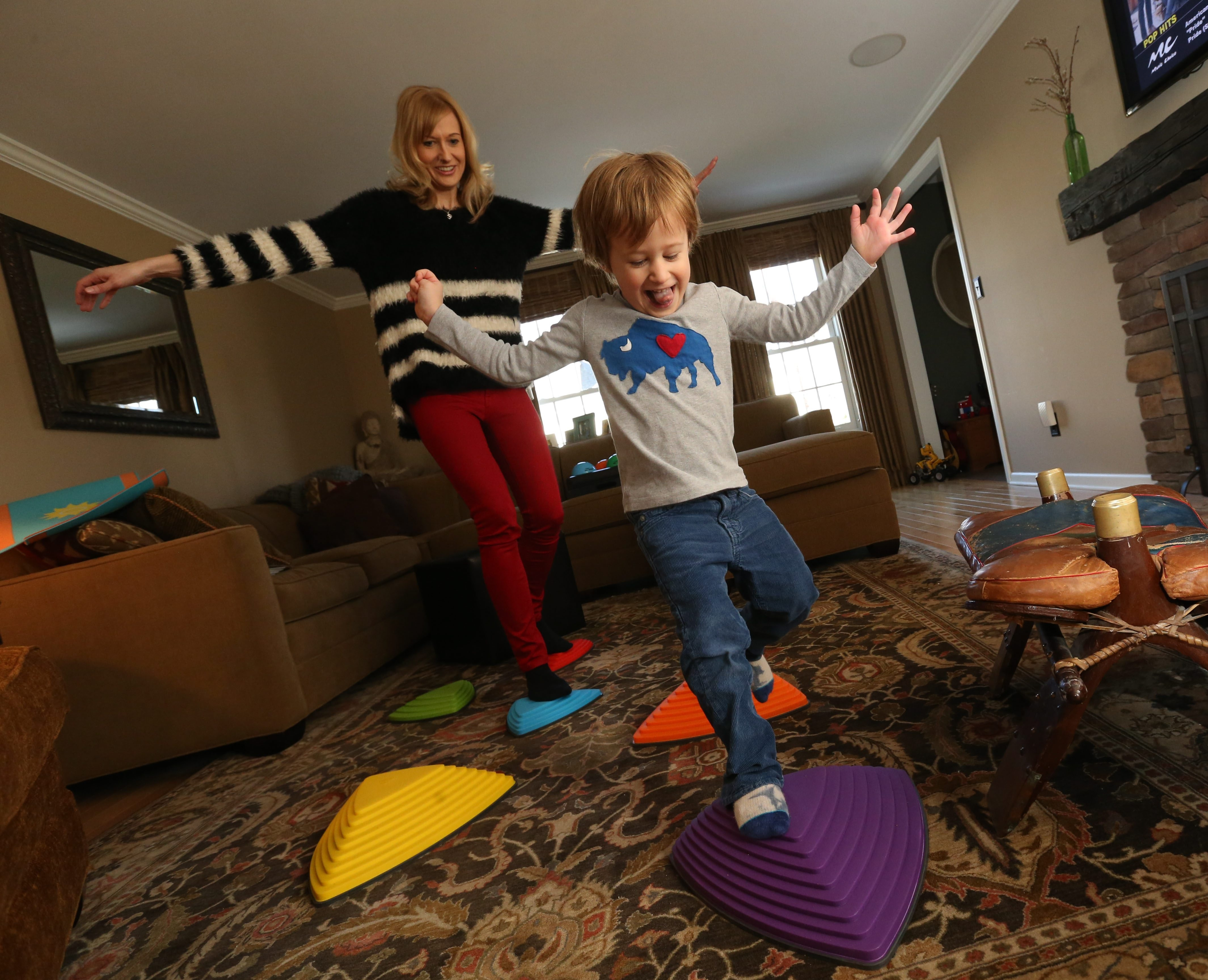 Christina Bleckinger likes to take her son, Henry, 4, for walks in Glen Park. She also enjoys putting colorful stepping pieces on the living room floor their Williamsville home so the two can pretend that they're jumping from rock to rock in a pond or stream.