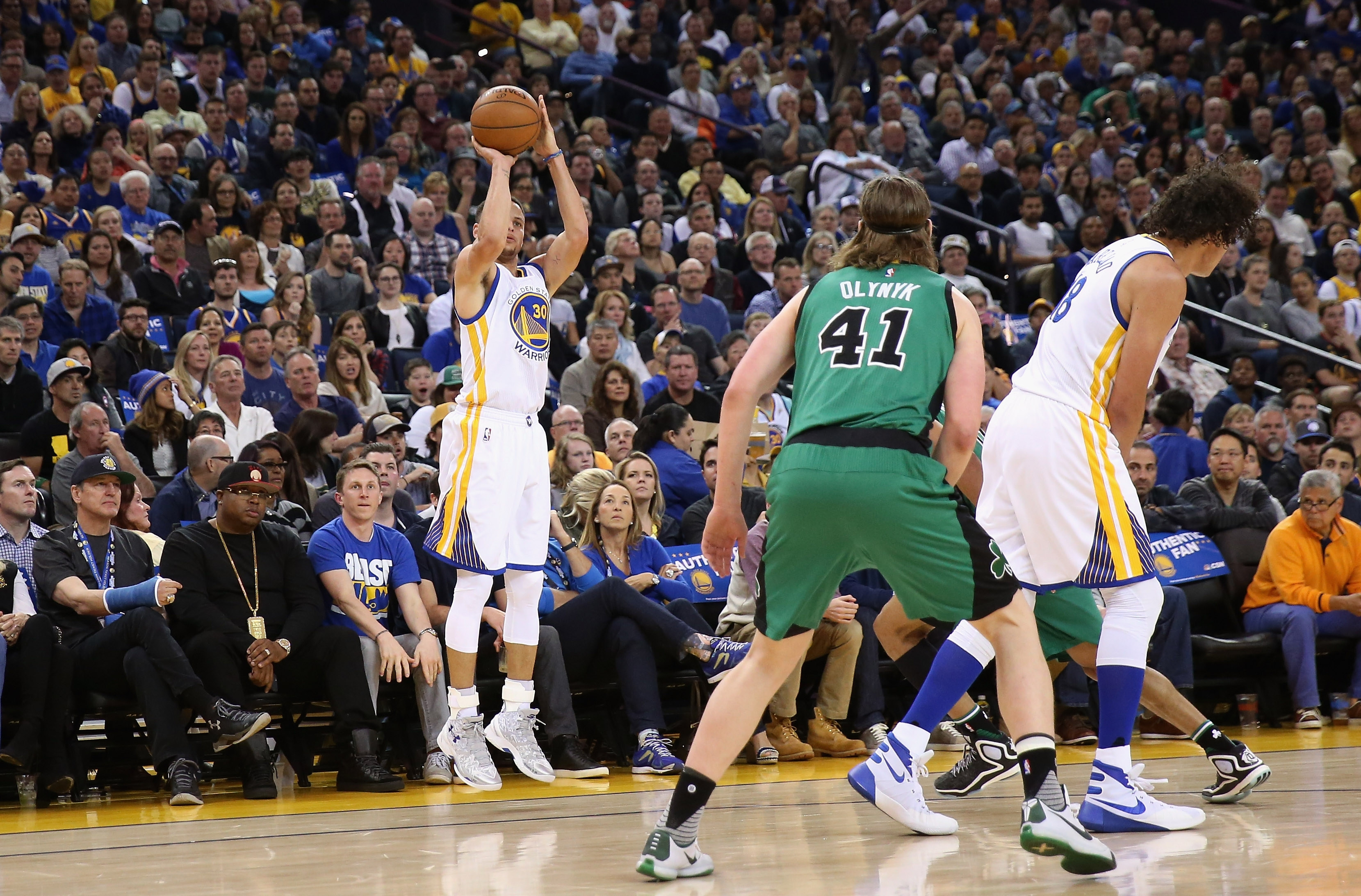 Stephen Curry of the Golden State Warriors shoots a three-point basket against the Boston Celtics at Oracle Arena on Saturday in Oakland, Calif.