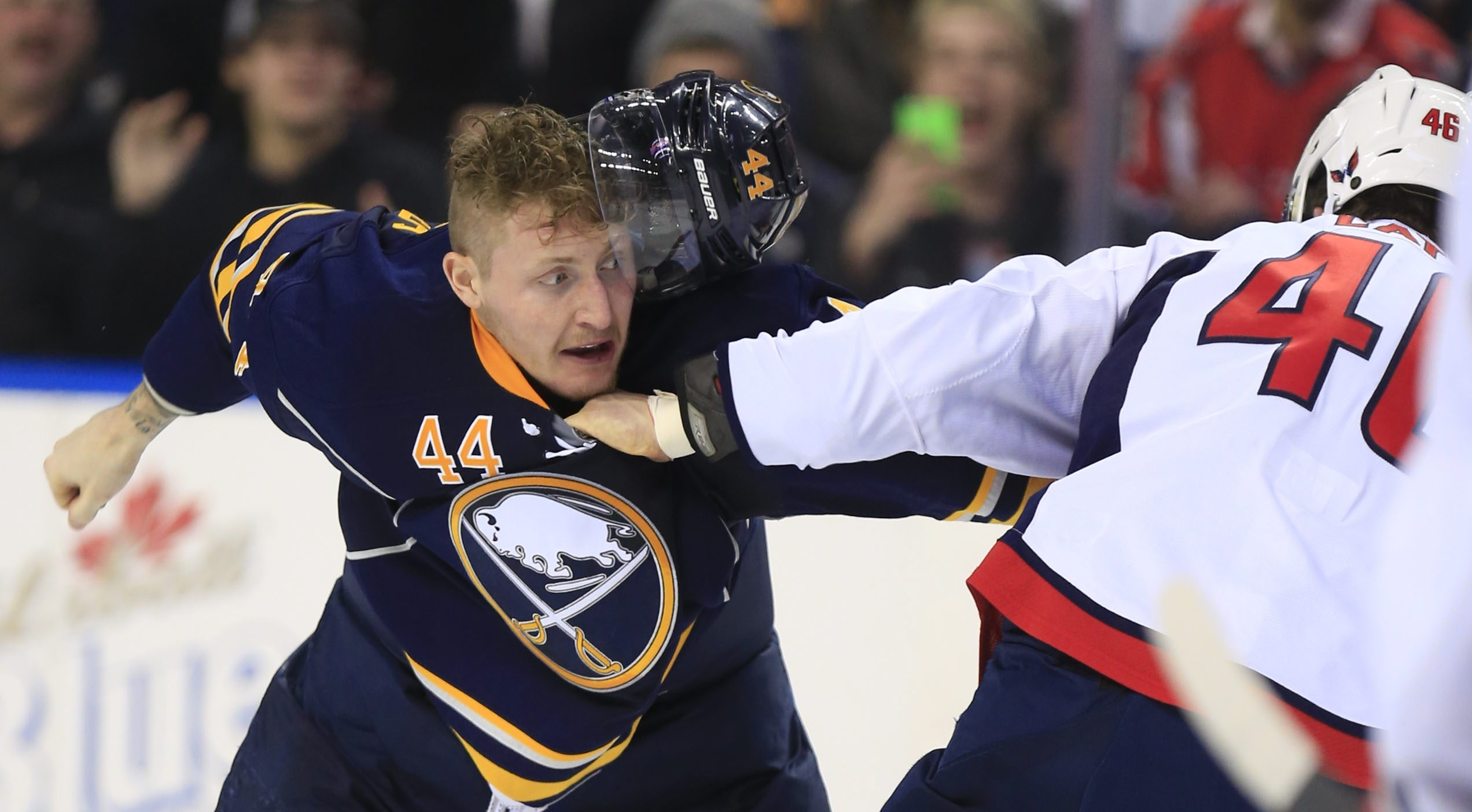 Buffalo Sabres left winger Nicolas Deslauriers fights Washington Capitals center Michael Latta during second-period action at the First Niagara Center on Dec. 28, 2015.