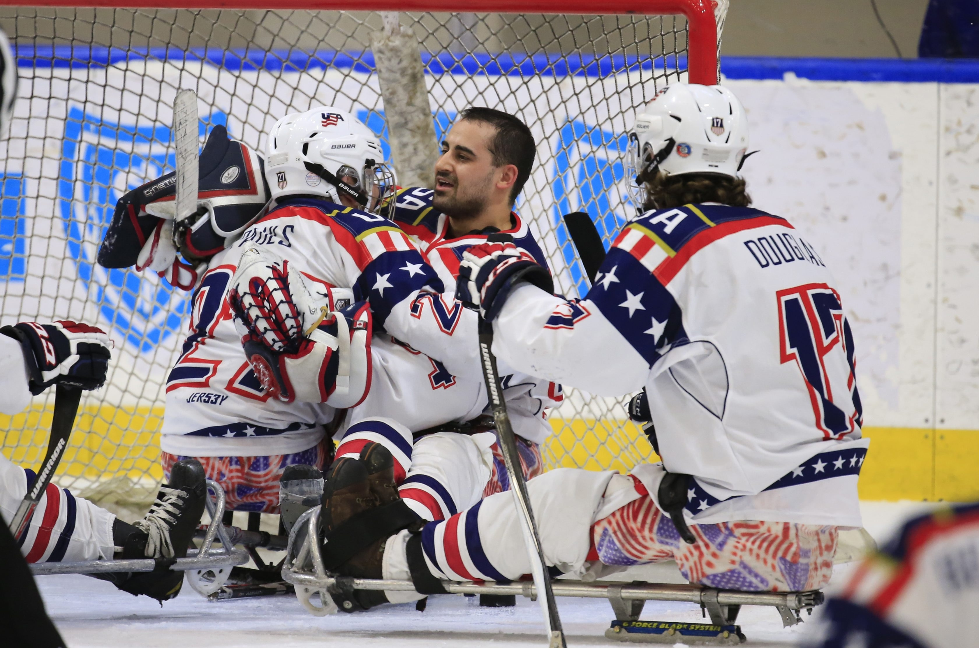 USA celebrates a 4-1 victory over Canada in the Gold Medal Pan Pacific Sled Hockey Championship game at HarborCenter.