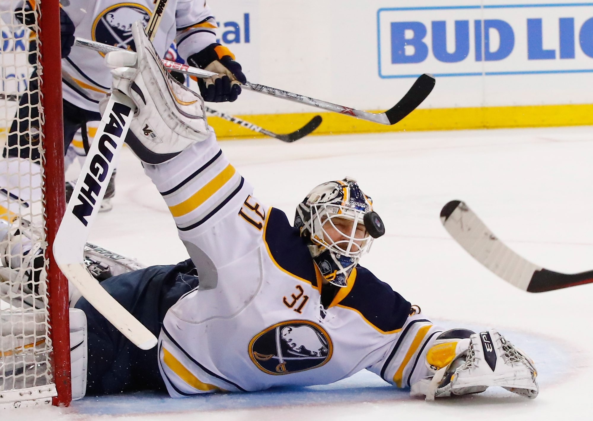 Chad Johnson keeps his eye on the puck in making a save for the Sabres in their win over the Rangers on Saturday.