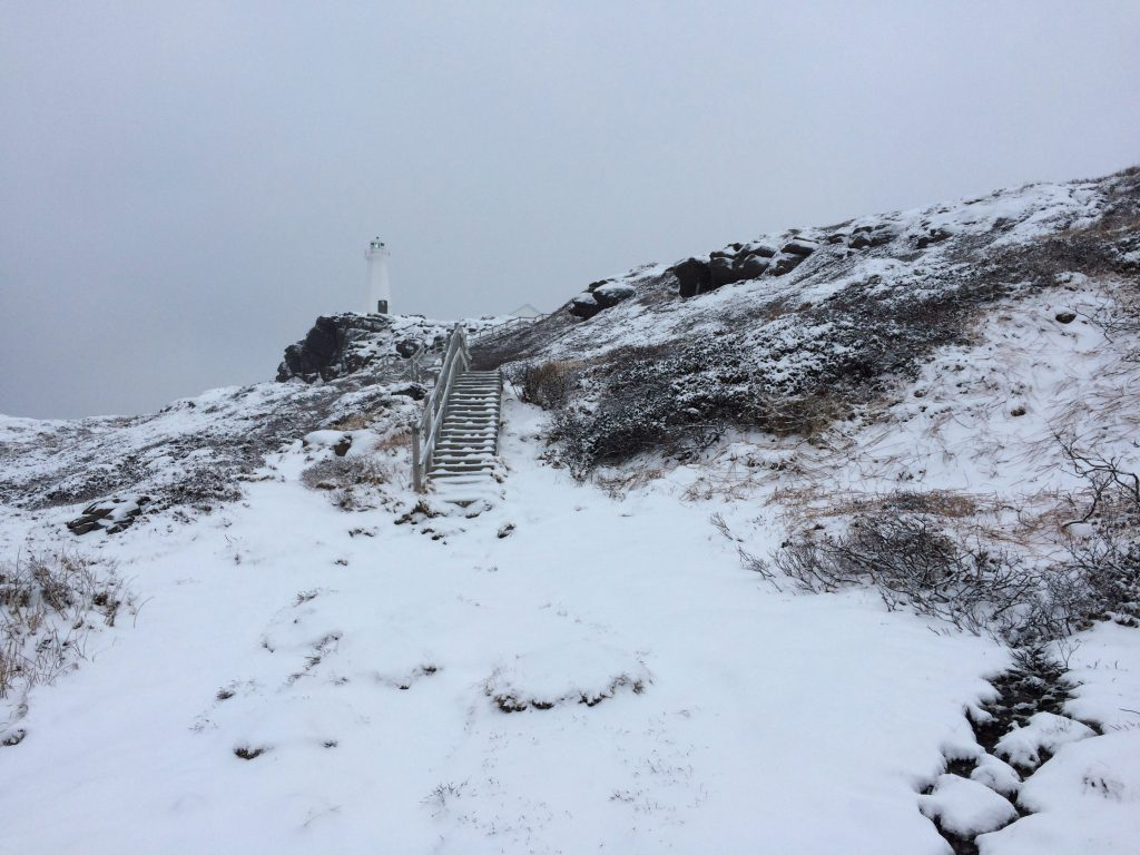 Wooden stairs, covered in snow, leading up to the Cape Spear lighthouse in St. John's, Newfoundland.