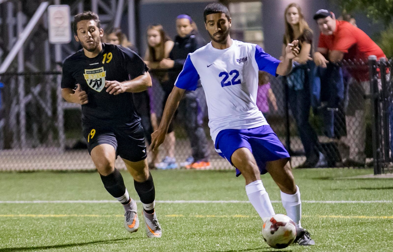 Adel Rahman, right, played a reserve midfield role for the Purple Eagles last fall. (Don Nieman/Special to The News)