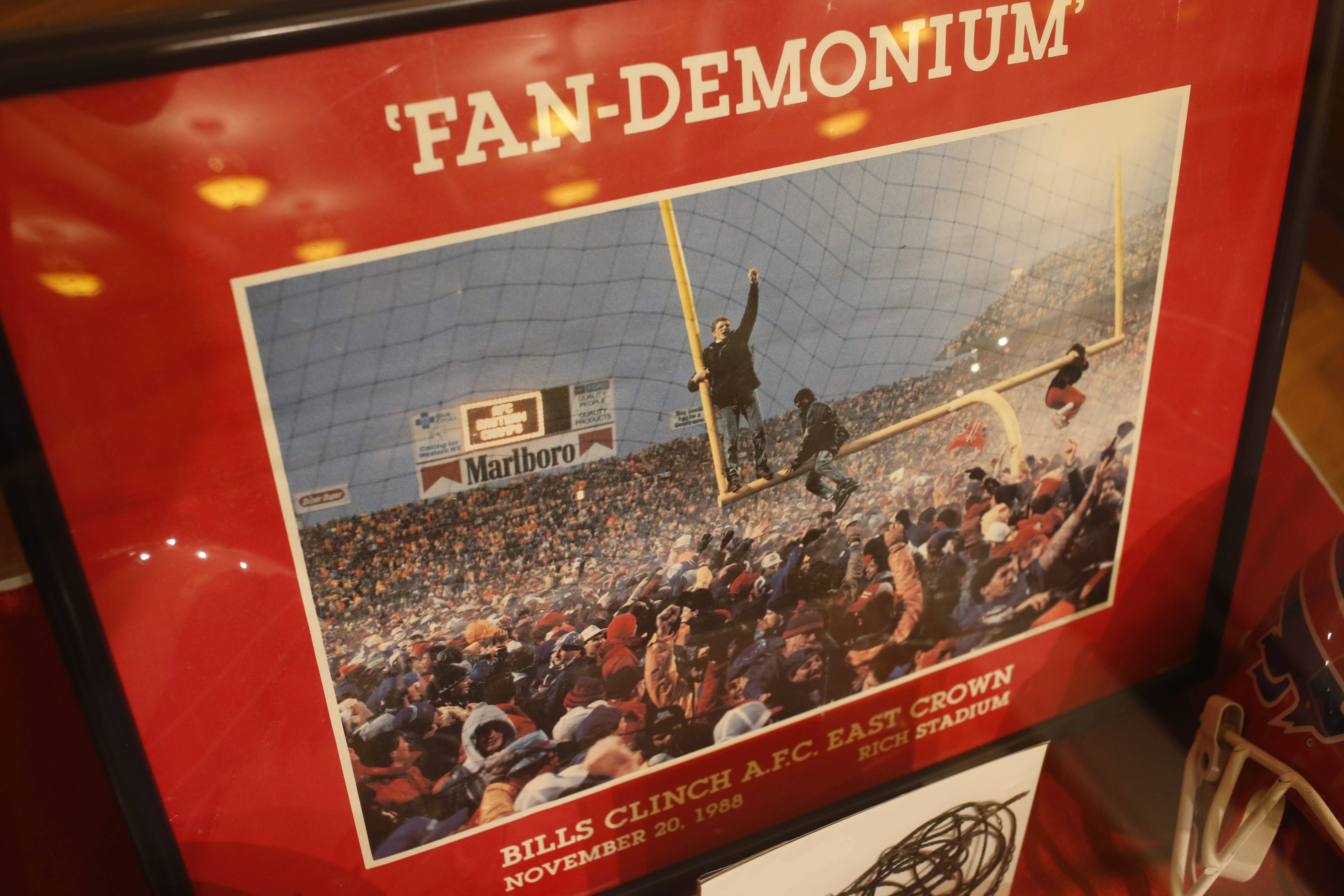 A poster from the 1988 AFC East championship game against the Jets, better known by fans as the 'Fan-Demonium' game, from the collection of Bills fan Greg Tranter on display at the Buffalo History Museum, Tuesday, April 26, 2016.  (Derek Gee/Buffalo News)