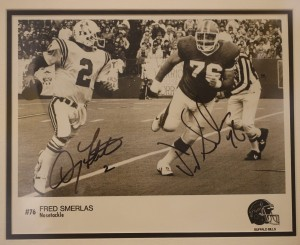 A photograph of Fred Smerlas, right, about to tackle New England Patriots quarterback Doug Flutie, signed by both players, from the collection of Bills fan Greg Tranter on display at the Buffalo History Museum, Tuesday, April 26, 2016. (Derek Gee/Buffalo News)