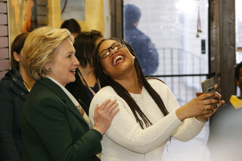 Hillary Clinton poses for a photo with a supporter during a campaign stop at Golden Cup Coffee Co. in Buffalo on Friday.  (Derek Gee/Buffalo News)