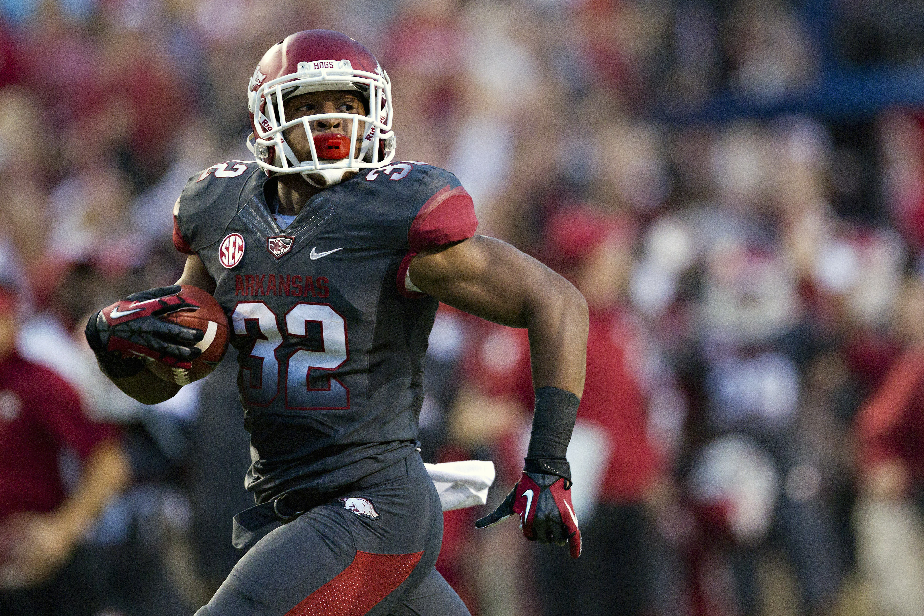 Jonathan Williams of Arkansas rushes for a 74-yard touchdown against Kentucky in 2012.  (Getty Images)