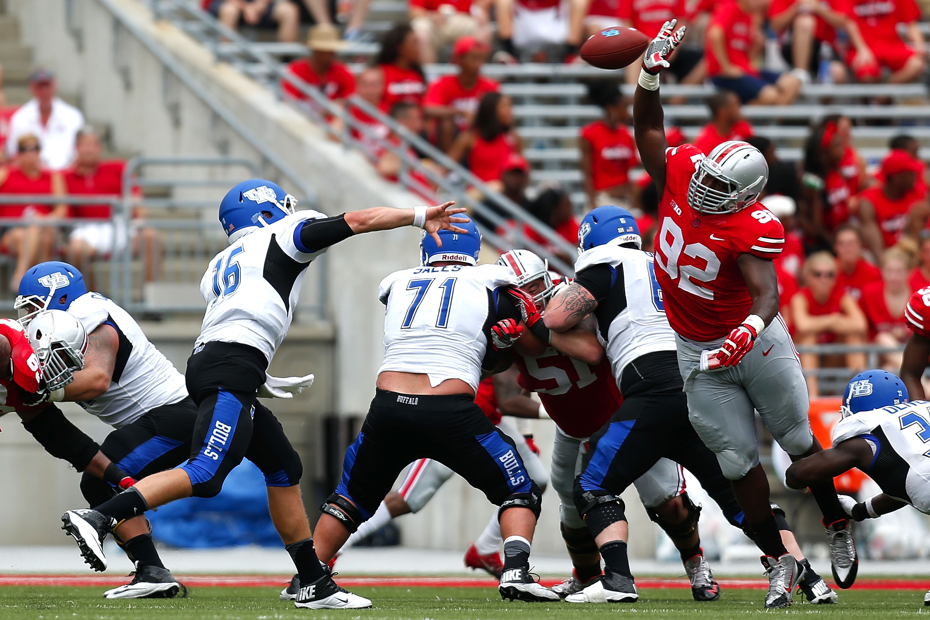 Adolphus Washington of Ohio State charged UB's Joe Licata, but Licata hit Alex Neutz for a touchdown on the play during the teams' 2013 matchup. (Getty Images)