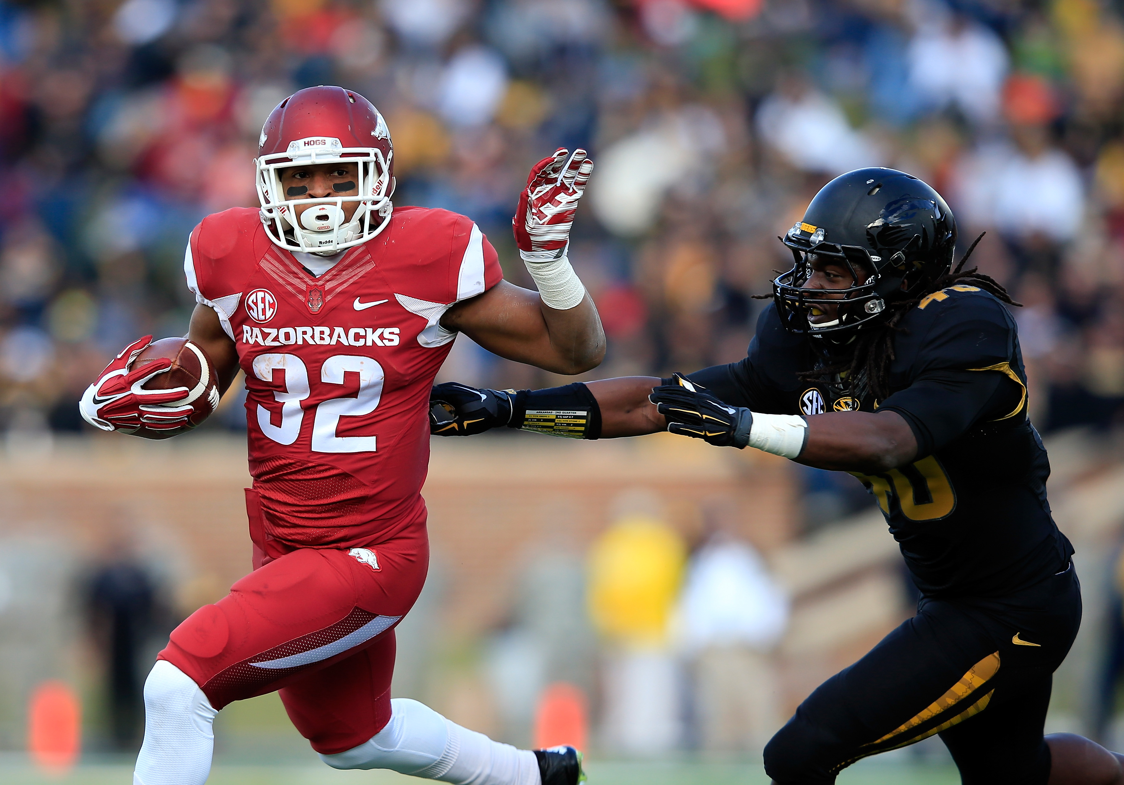 Jonathan Williams of the Arkansas Razorbacks carries the ball against Missouri on Nov. 28, 2014.  (Getty Images)