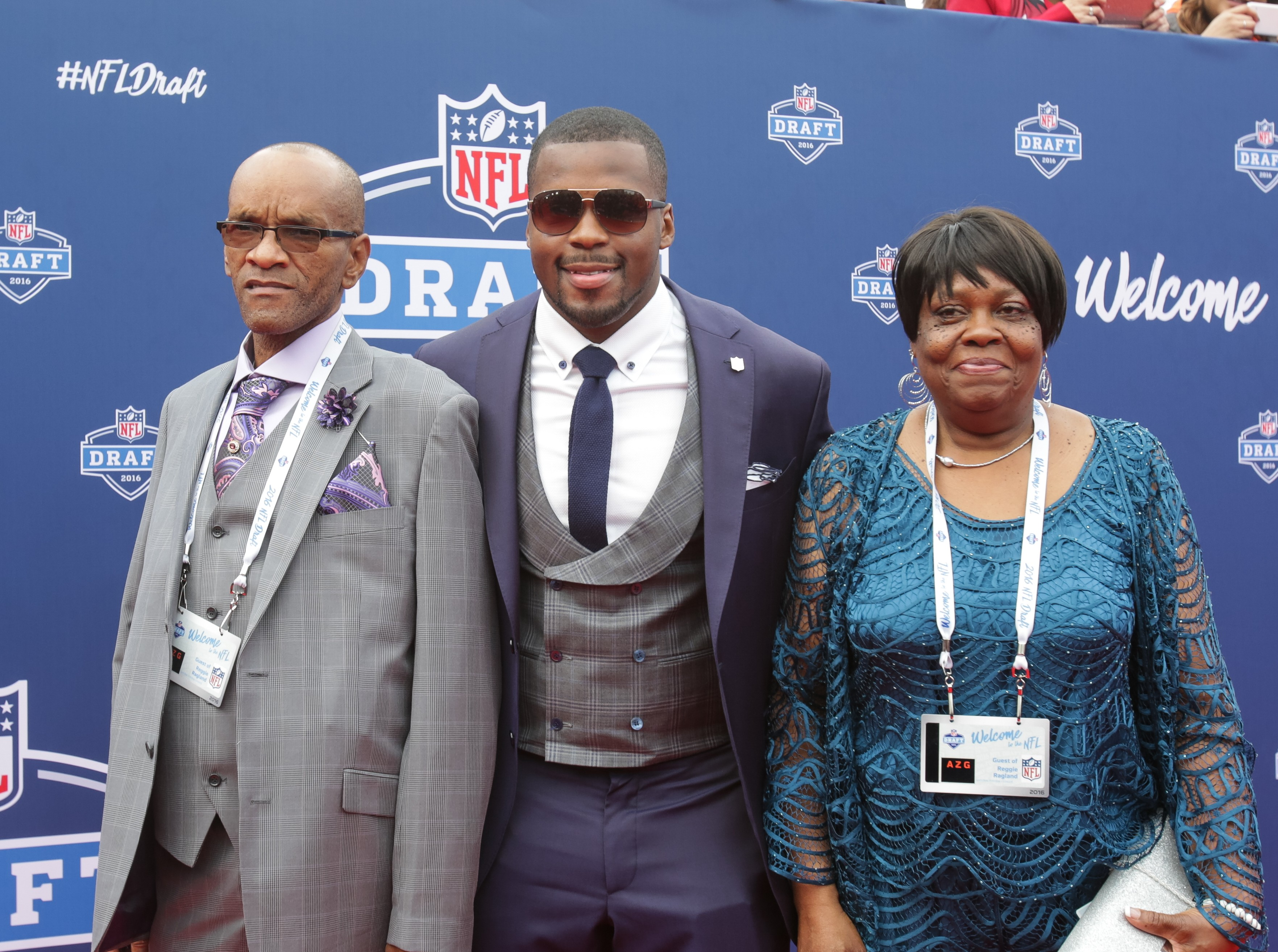 Draftee Reggie Ragland of Alabama with his dad Reggie Ragland, Sr. and mom Ann White arrive at the 2016 NFL Draft on Thursday. (Getty Images)