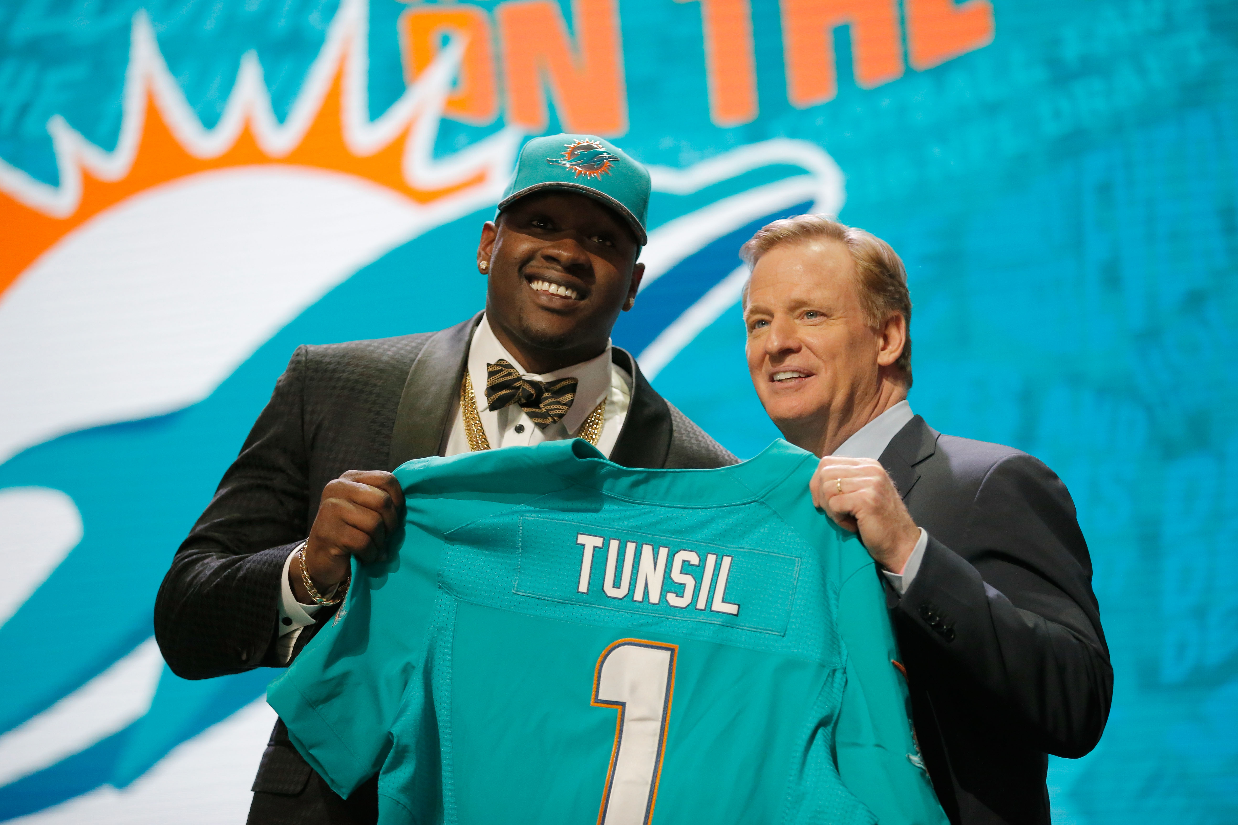 Laremy Tunsil of Ole Miss -- who had a long wait -- is greeted by NFL Commissioner Roger Goodell after being picked 13th overall by the Miami Dolphins.  (Getty Images)