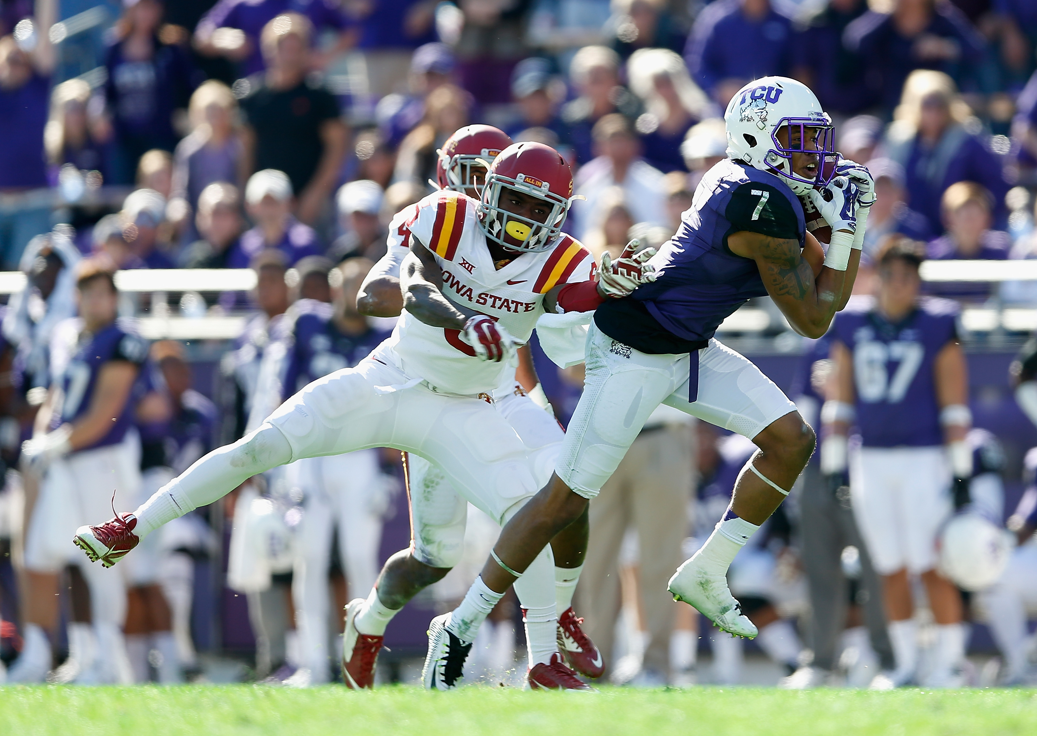 FORT WORTH, TX - DECEMBER 06:  Wide receiver Kolby Listenbee #7 of the TCU Horned Frogs catches a 49 yard reception past defensive back Kamari Cotton-Moya #5 of the Iowa State Cyclones during the second quarter of the Big 12 college football game at Amon G. Carter Stadium on December 6, 2014 in Fort Worth, Texas. The Horned Frongs defeated the Cyclones 55-3.  (Photo by Christian Petersen/Getty Images)