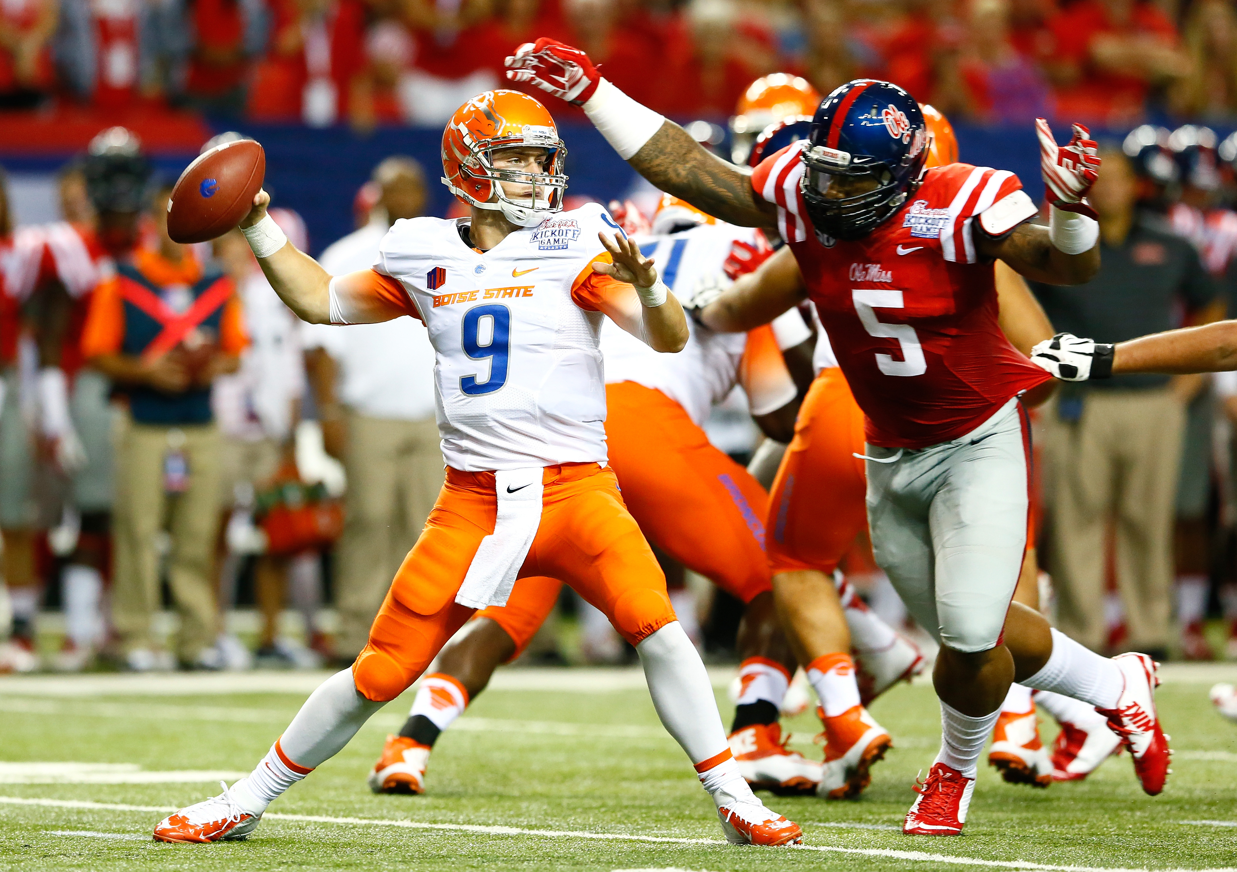 ATLANTA, GA - AUGUST 28:  Robert Nkemdiche #5 of the Mississippi Rebels pressures Grant Hedrick #9 of the Boise State Broncos at Georgia Dome on August 28, 2014 in Atlanta, Georgia.  (Photo by Kevin C. Cox/Getty Images)