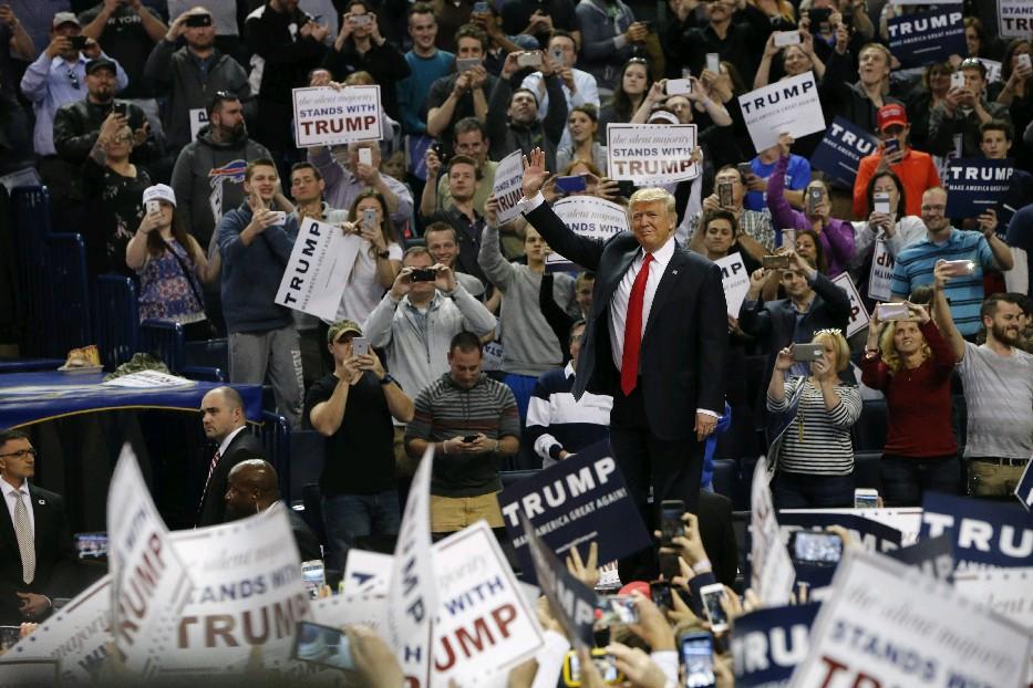 Donald Trump makes his entrance at the First Niagara Center on Monday.  (Derek Gee/Buffalo News)