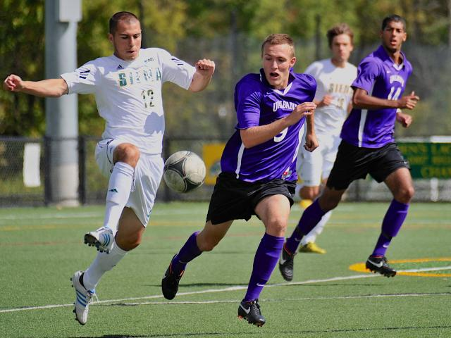 Philip Persson, second from left, chases down a Siena midfielder. (Albany Athletics)