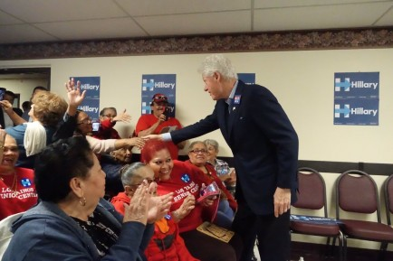 Former President Bill Clinton greets residents playing bingo in St. John Towers in Buffalo on Monday morning. (John Hickey/Buffalo News)