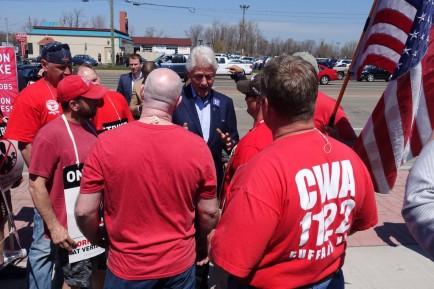 Former President Bill Clinton speaks Monday afternoon with striking Verizon workers in Cheektowaga. (John Hickey/Buffalo News)