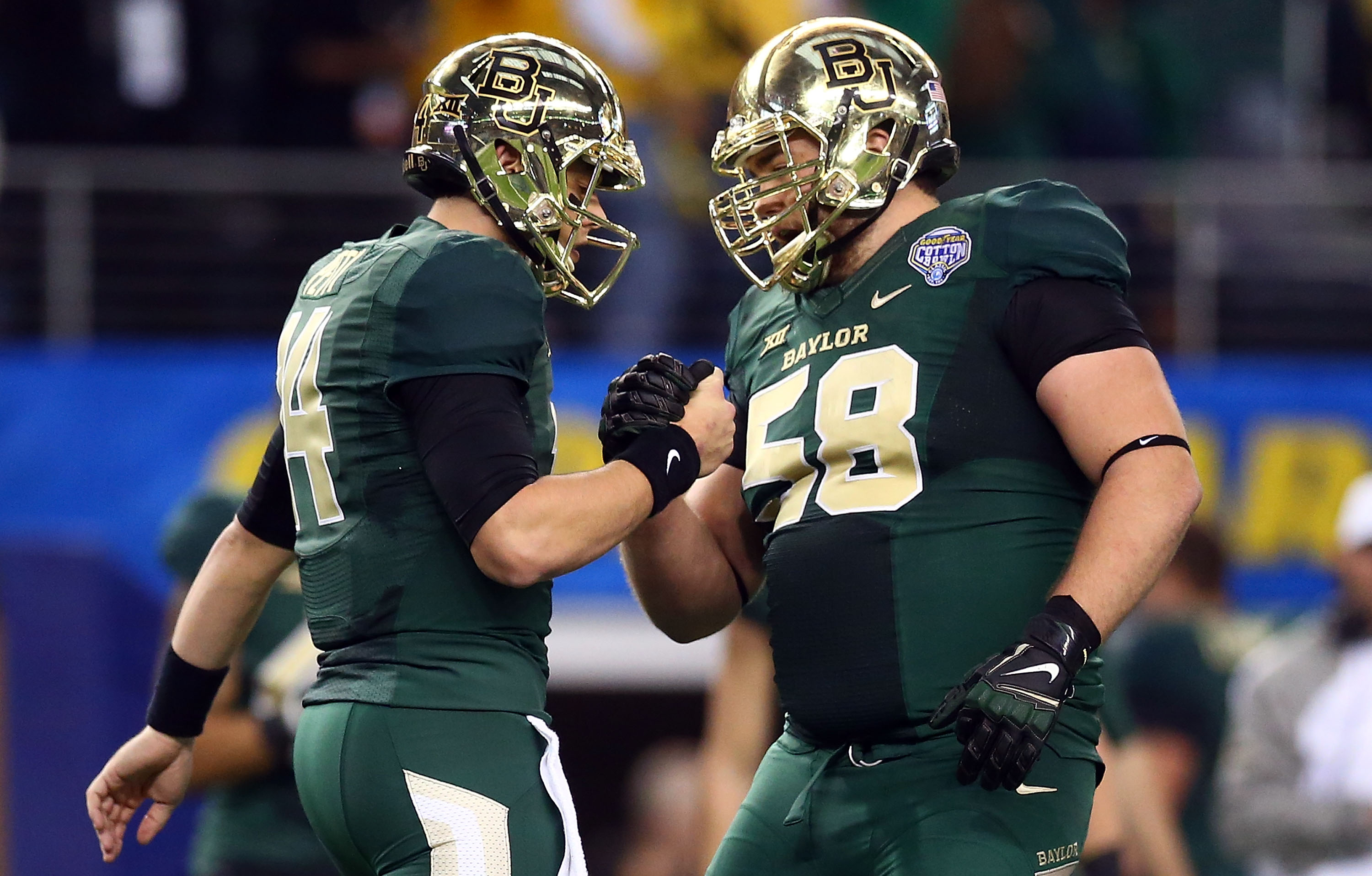 ARLINGTON, TX - JANUARY 01:  Bryce Petty #14 of the Baylor Bears and Spencer Drango #58 of the Baylor Bears celebrate after a touchdown against the  Michigan State Spartans during the second half of the Goodyear Cotton Bowl Classic at AT&T Stadium on January 1, 2015 in Arlington, Texas.  (Photo by Ronald Martinez/Getty Images)