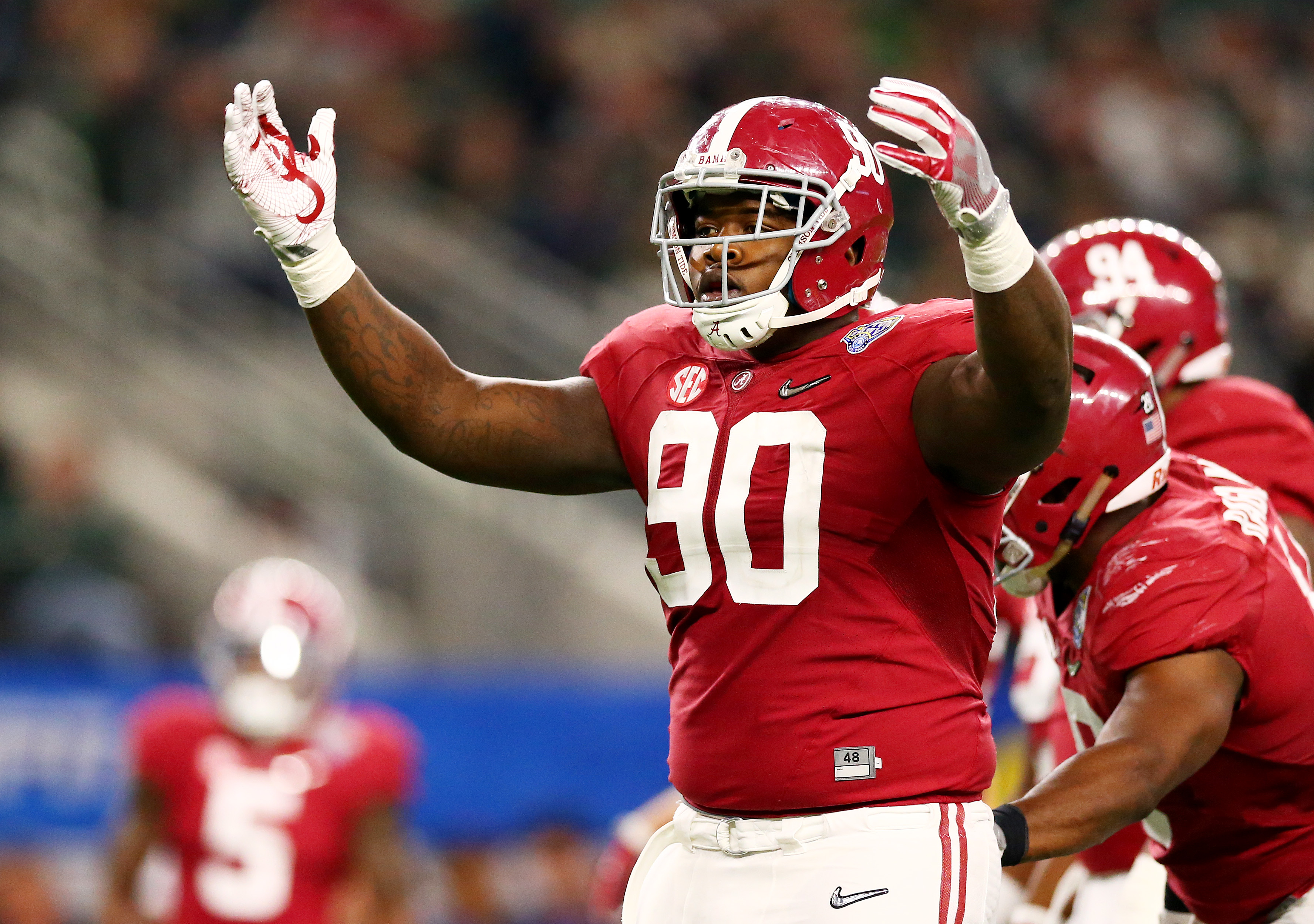ARLINGTON, TX - DECEMBER 31:  Jarran Reed #90 of the Alabama Crimson Tide reacts in the second half against the Michigan State Spartans during the Goodyear Cotton Bowl at AT&T Stadium on December 31, 2015 in Arlington, Texas.  (Photo by Ronald Martinez/Getty Images)