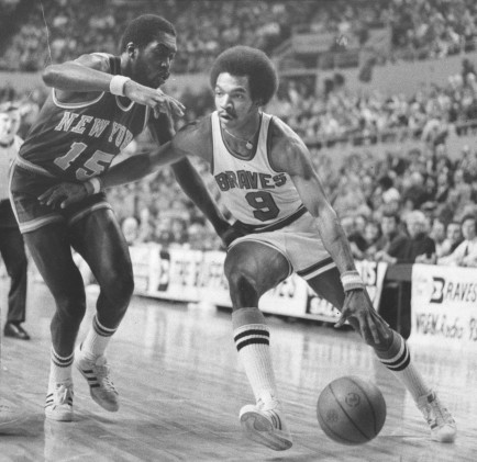 Buffalo Braves' Randy Smith drives to the basket past Earl Monroe of the New York Knicks in a January 24, 1975 game in Memorial Auditorium in Buffalo, N.Y. Smith scored 32 points in Buffalo's 105-99 victory. Buffalo News file photo by Robert L. Smith