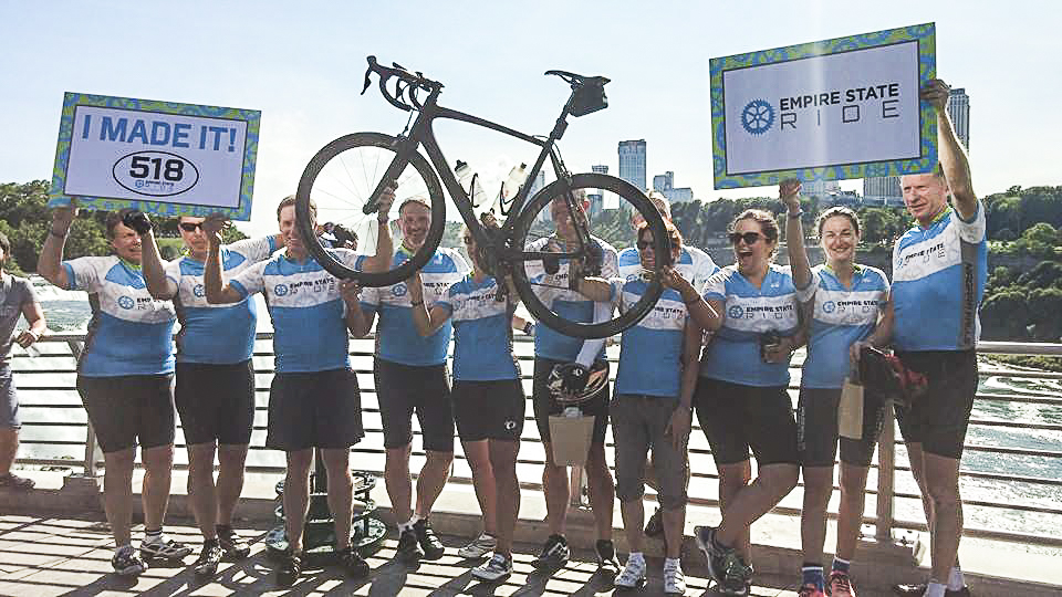 Empire State Ride bikers celebrate last year in Niagara Falls State Park at the finish of  the fundraising ride.
