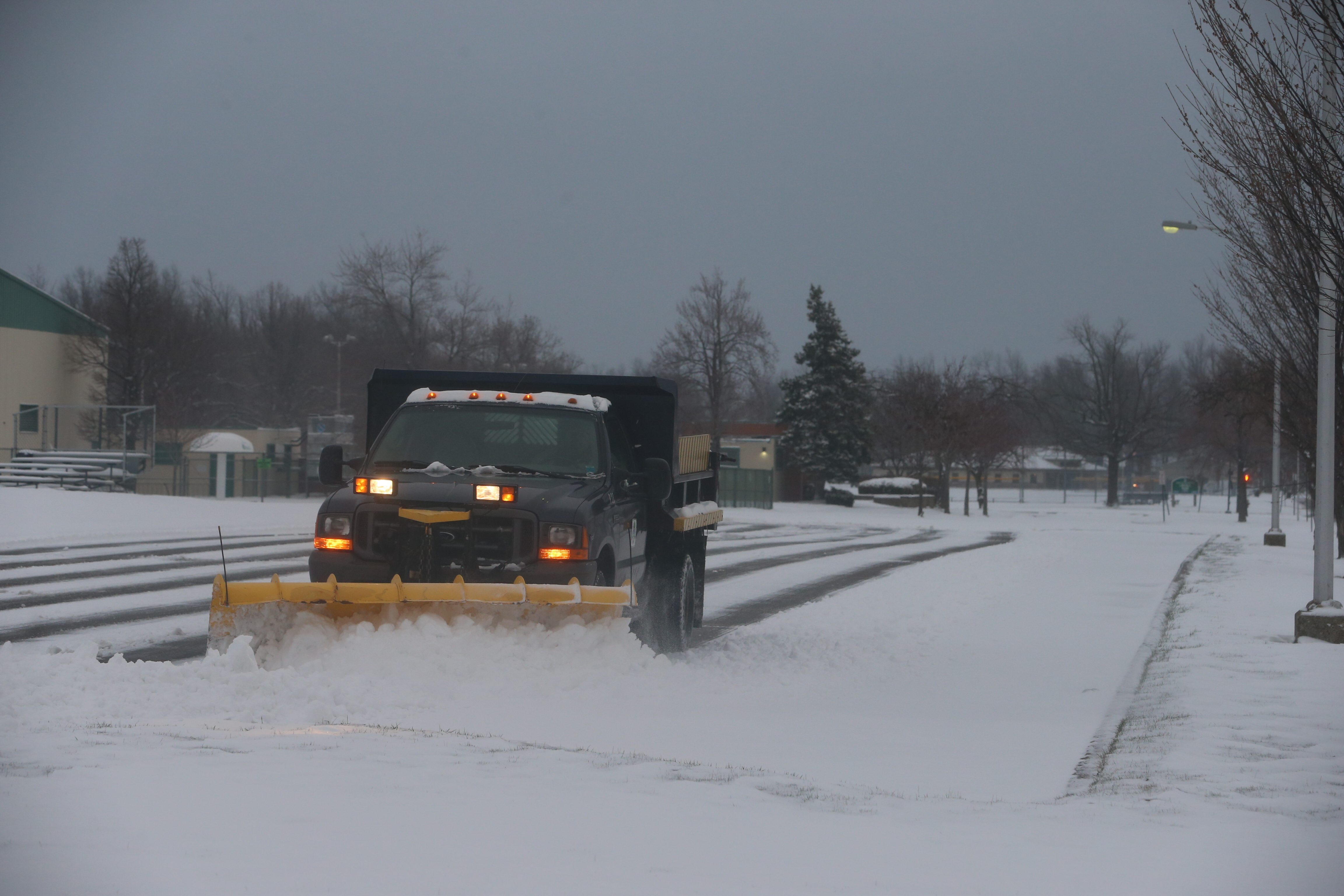 A plow clears a parking lot  Monday morning at Lincoln Park in the Town of Tonawanda. (John Hickey/Buffalo News)