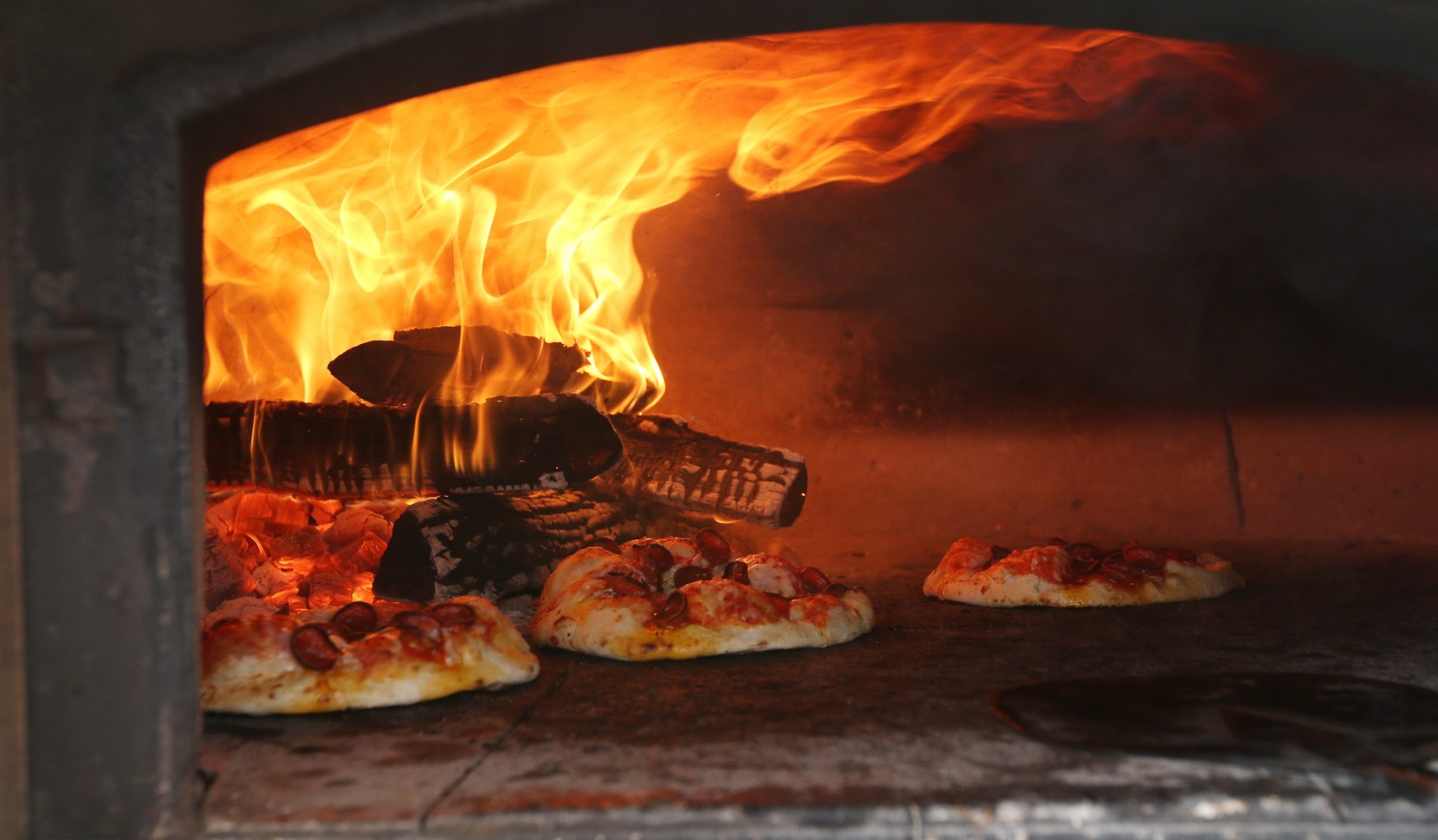 Pizza cooks remarkably fast in Pizza Amore's wood-fired oven. (Sharon Cantillon/Buffalo News)