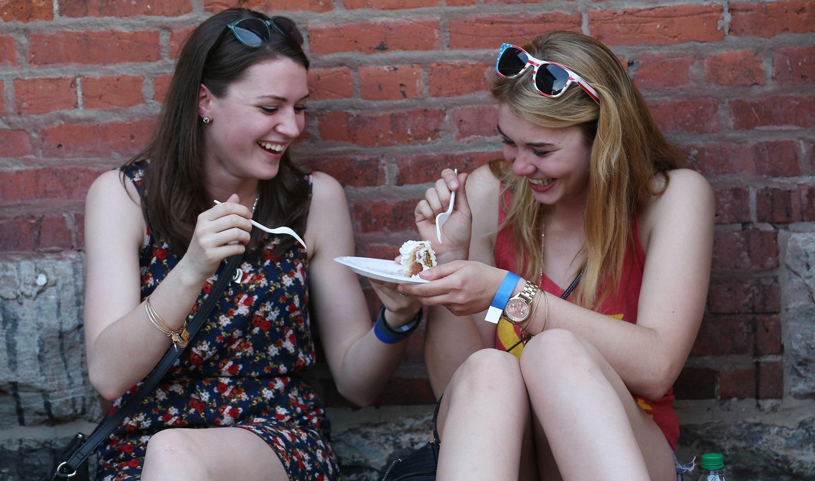 Lauren Orynawka, left, of Elma and Leanne Schad of Cheektowaga, share a strawberry shortcake from The Sweet Hearth. (Sharon Cantillon/Buffalo News file photo