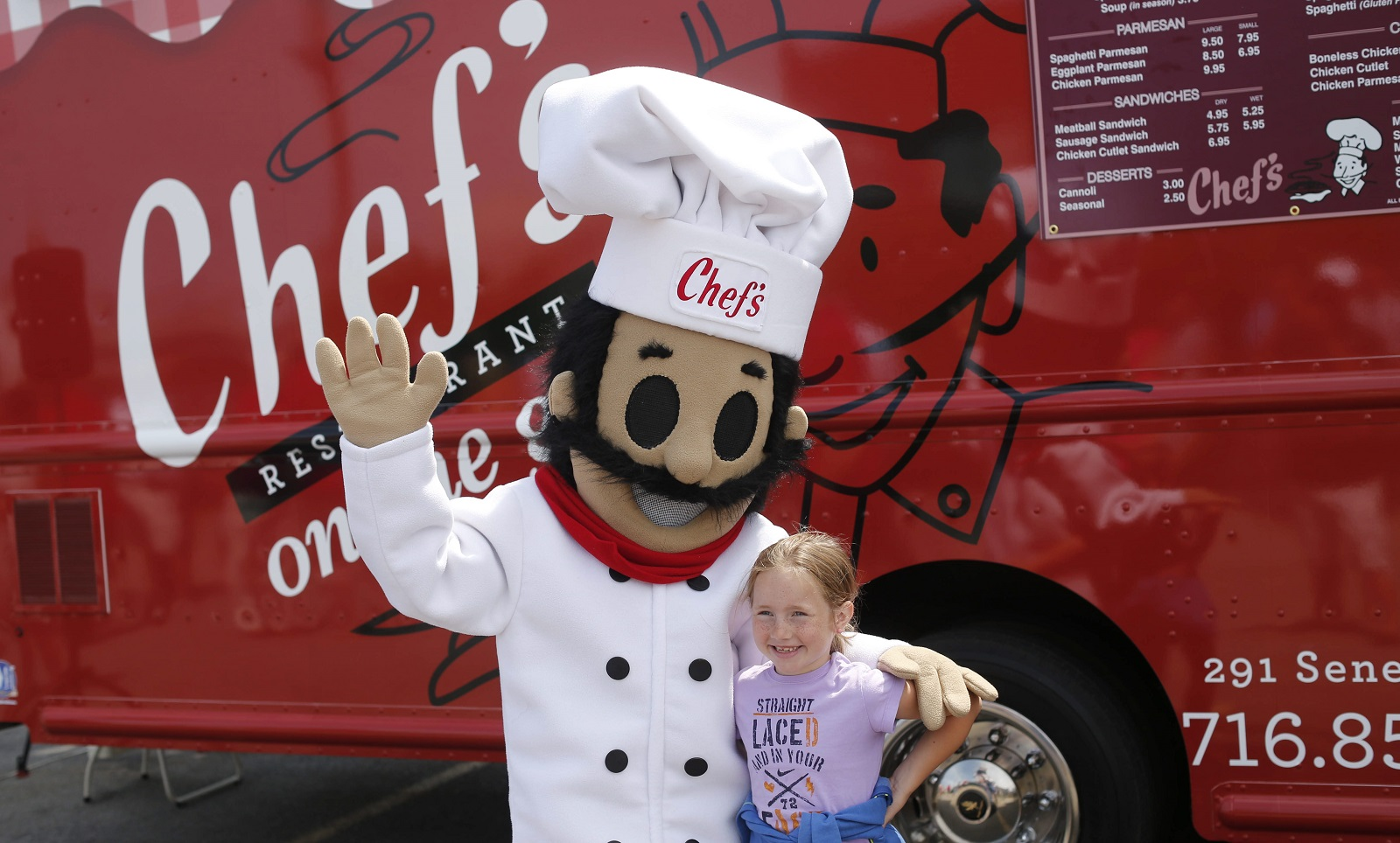 "Cameron Wilson, 8, of Lancaster poses for a photograph with ""Paisano"" after the new Chef's Restaurant food truck was unveiled in July 2015. (Derek Gee/Buffalo News file photo)"