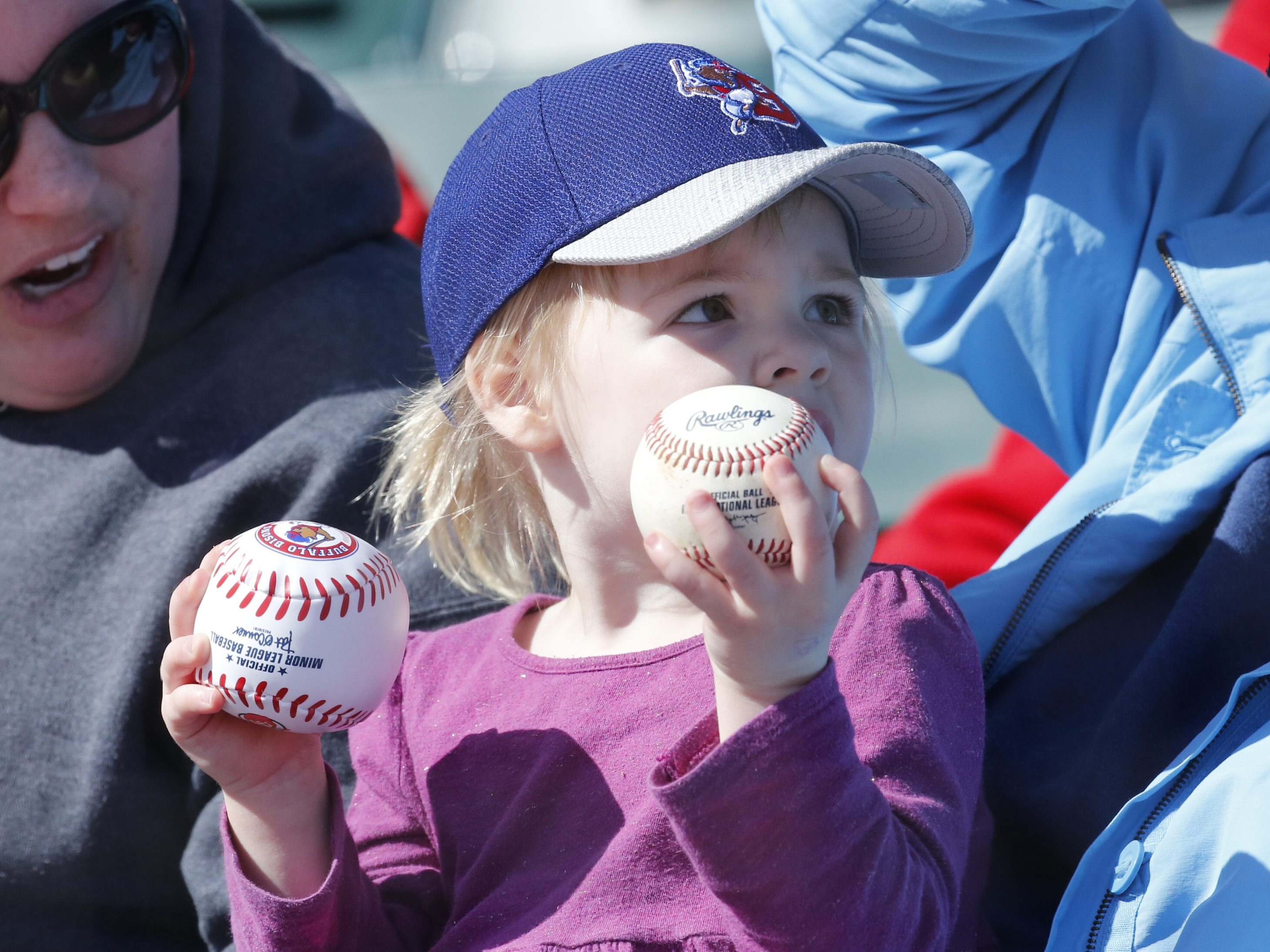 Buffalo Bisons Audrey Weil from Amherst hold some souviner balls during 7th inning action against the Rochester Red Wings at Coca-Cola Field on Thursday, April 14, 2016. (Harry Scull Jr./Buffalo News)