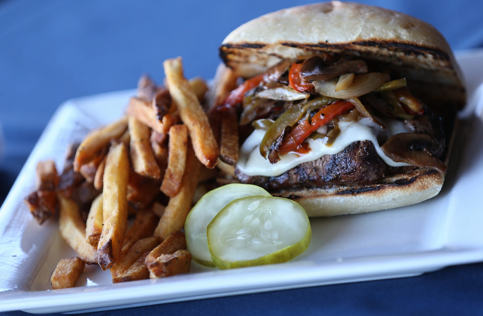 The Public House steak sandwich is made with Meyer filet mignon, mozzarella cheese, sautéed peppers, mushrooms and onions on a ciabatta roll. (Sharon Cantillon/Buffalo News)