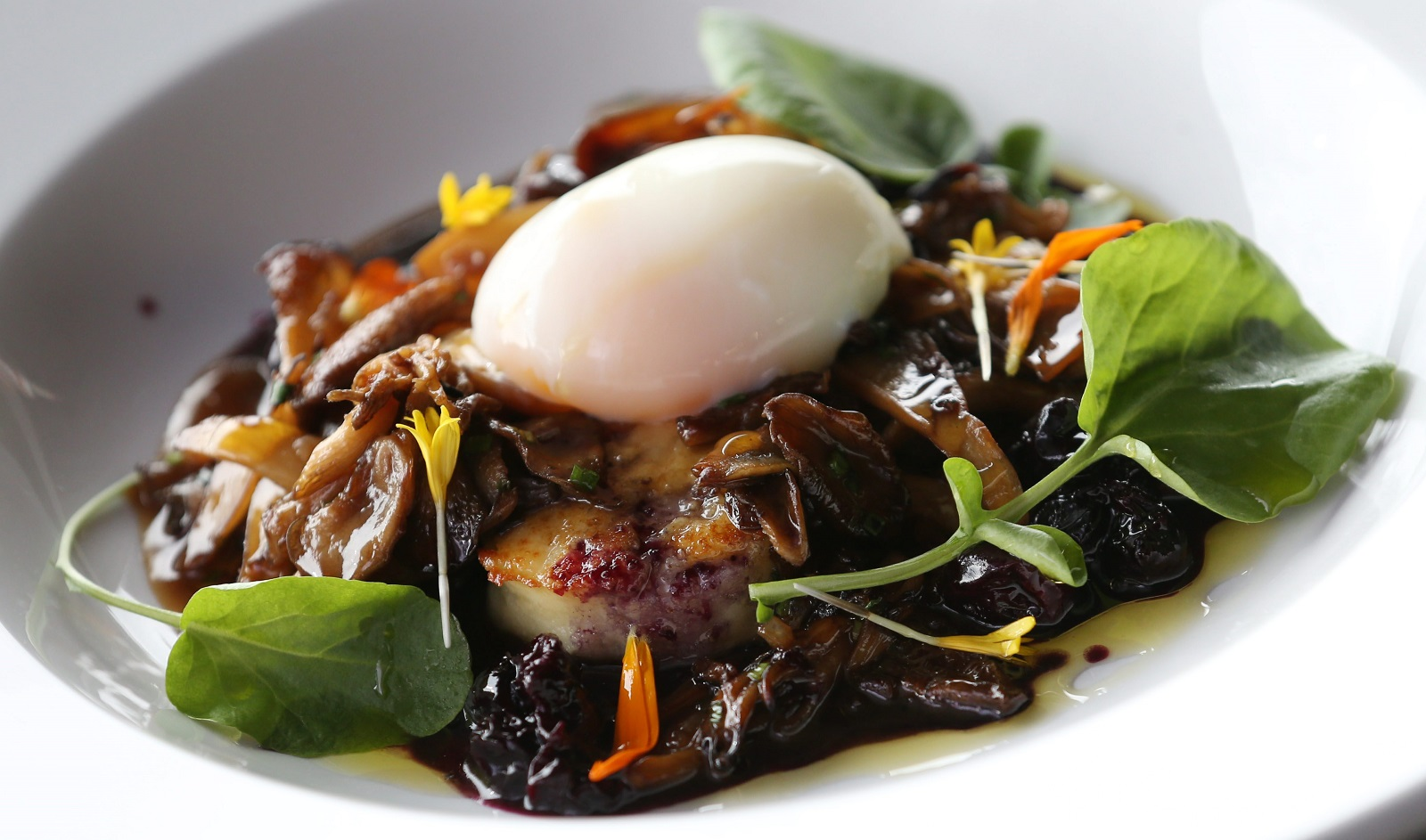 The Roman gnocchi comes with braised mushrooms, pork belly, 45-minute egg and blueberries. (Sharon Cantillon/Buffalo News)
