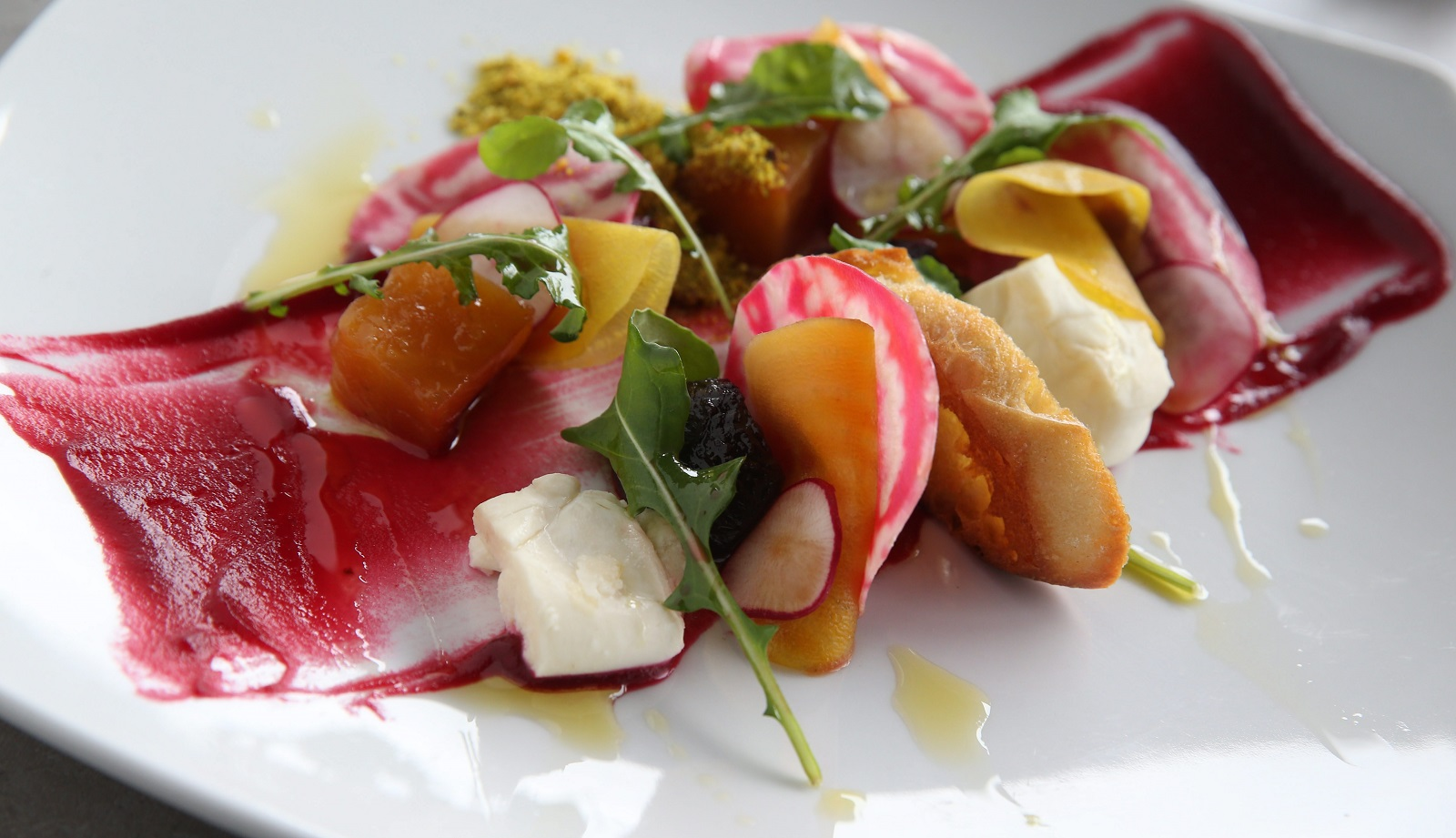 William K's roasted beets come with burrata, local honey, masala milk powder and garlic bread. (Sharon Cantillon/Buffalo News)