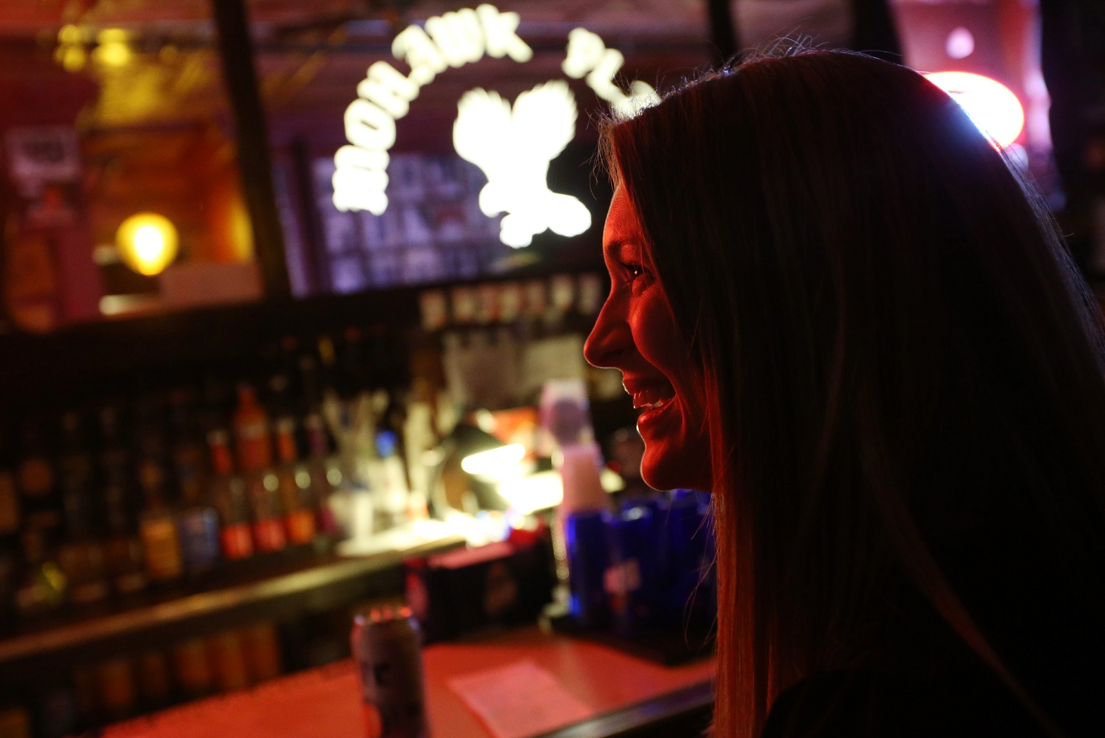 Erin Barrell, of Snyder, hangs out with friends at the bar before the opening act takes the Mohawk Place stage. (Sharon Cantillon/Buffalo News)