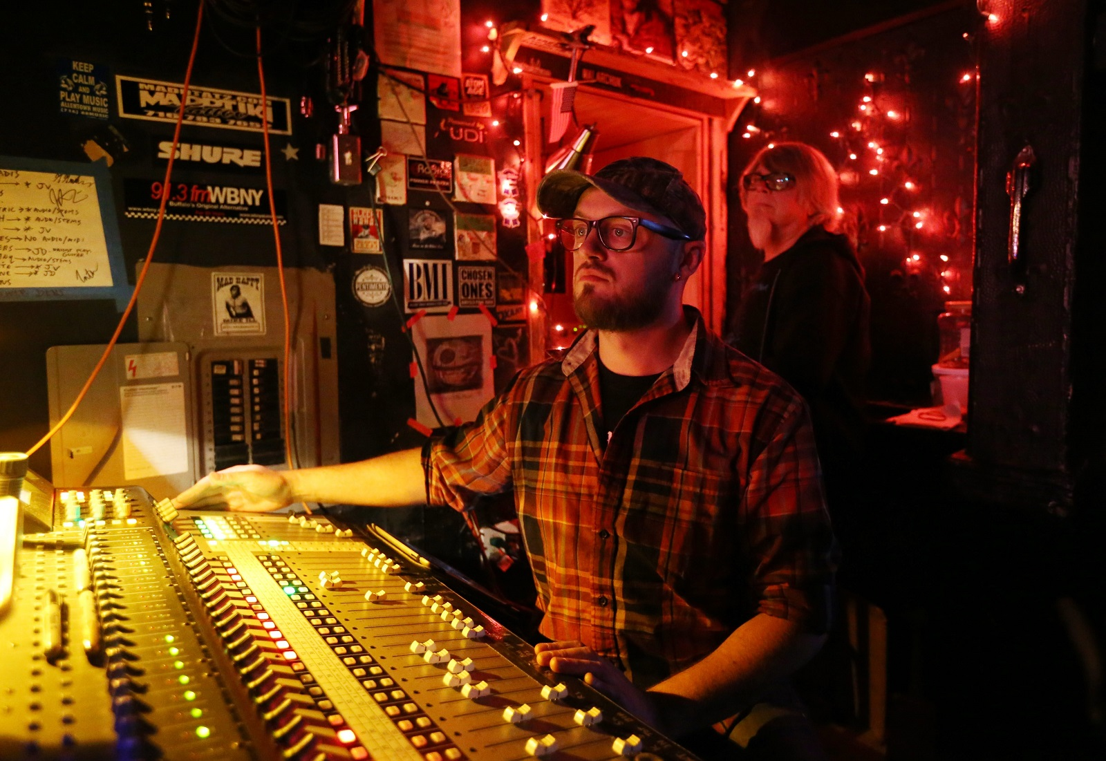 Mohawk Place's sound guy Tony DeRosa and light guy Dan Prabucki man their posts during a show. (Sharon Cantillon/Buffalo News)