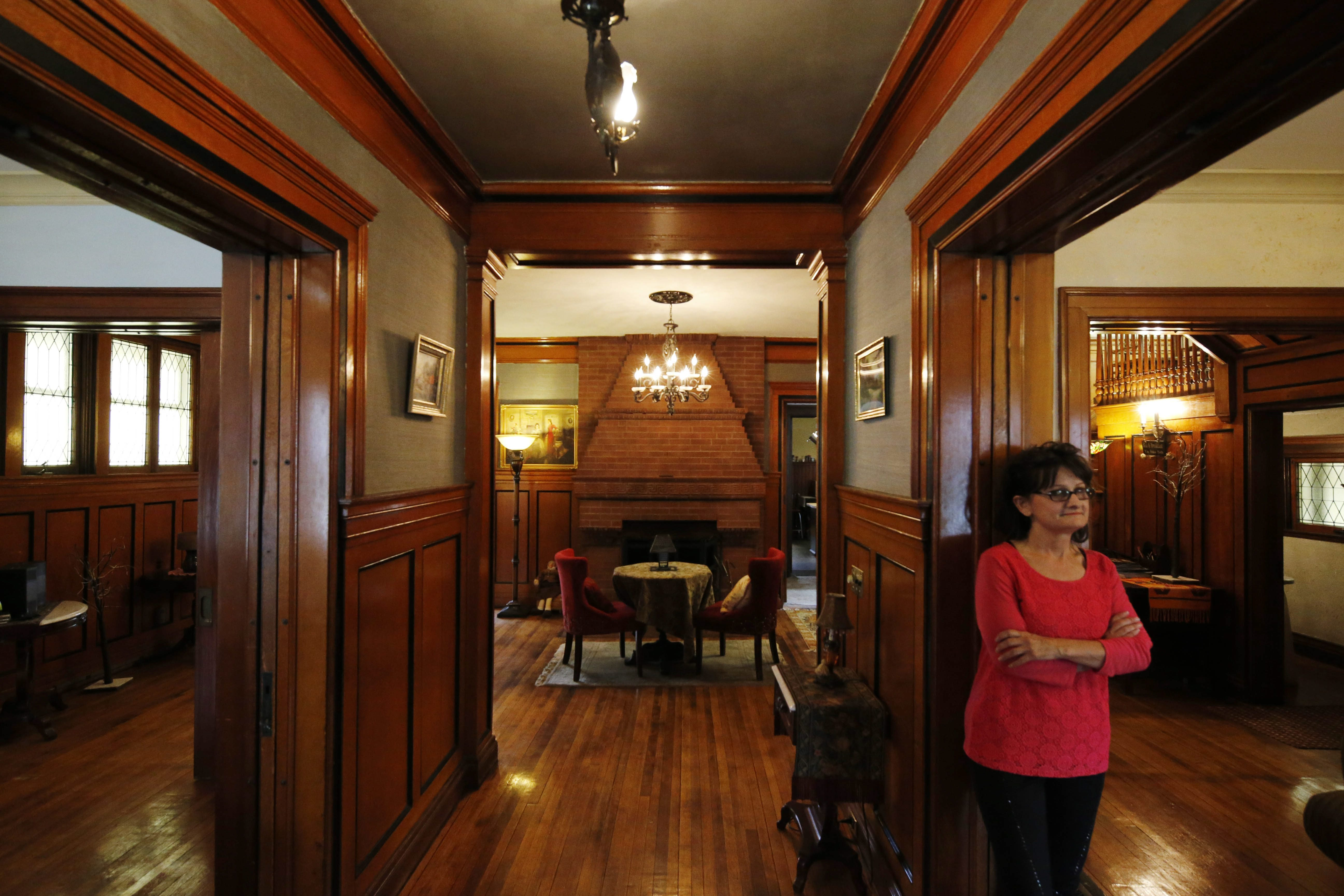Brenda Shaw, standing in her refurbished house, is on the May 15 Historic Linwood Tour of Homes. (Derek Gee/Buffalo News)