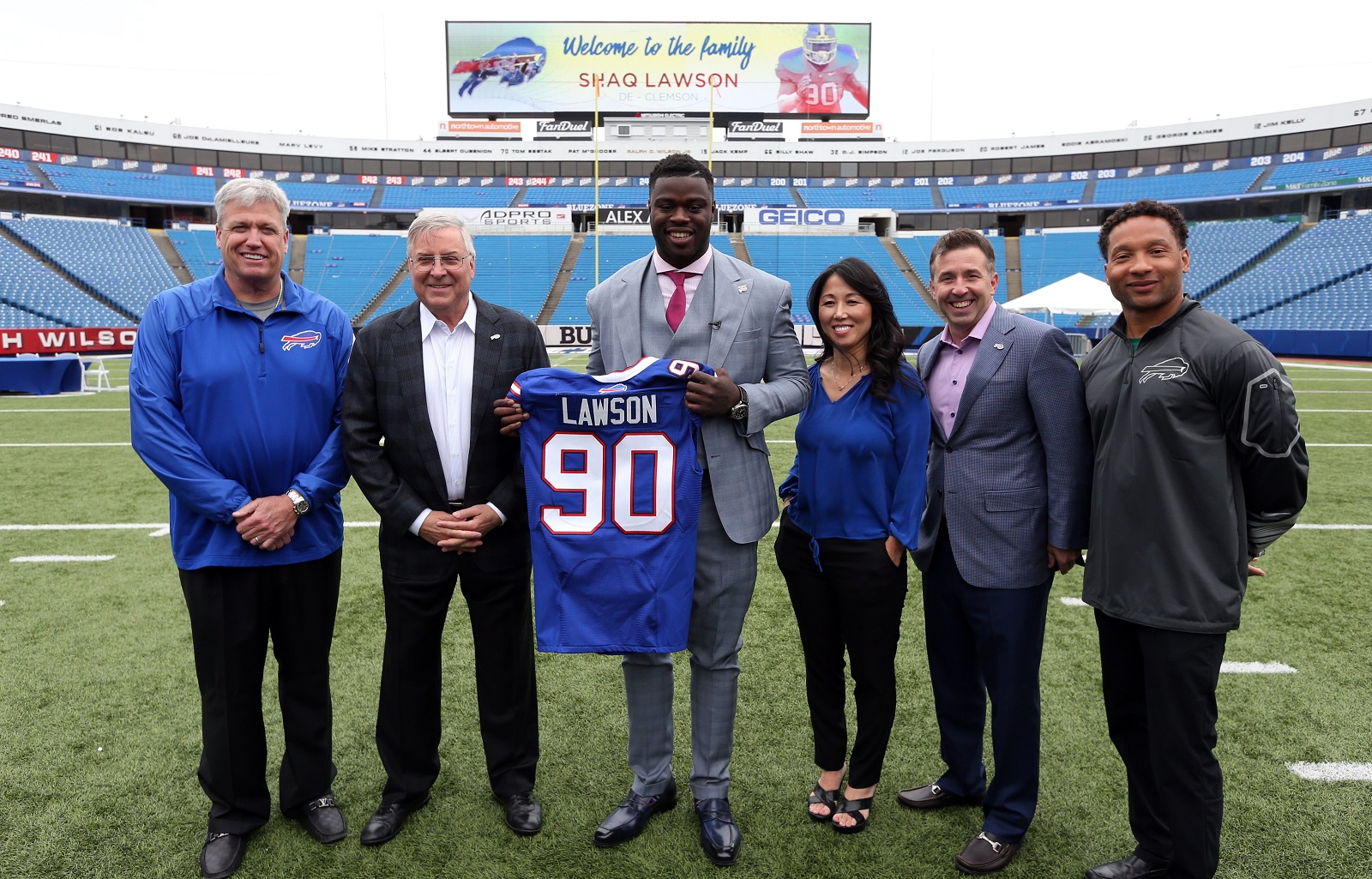 Shaq Lawson poses with the Bills' brass after being chosen as Buffalo's first-round pick. (James P. McCoy/Buffalo News)
