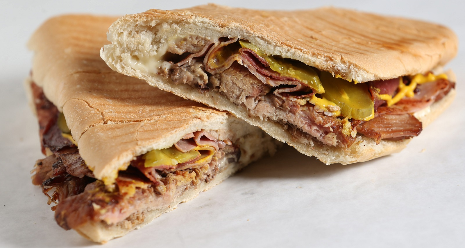 La Flor Bakery's Cubano is made with Cuban bread and filled with roasted pork, ham, salami, pickles, white cheese and mustard and toasted in a panini press. (Sharon Cantillon/Buffalo News)