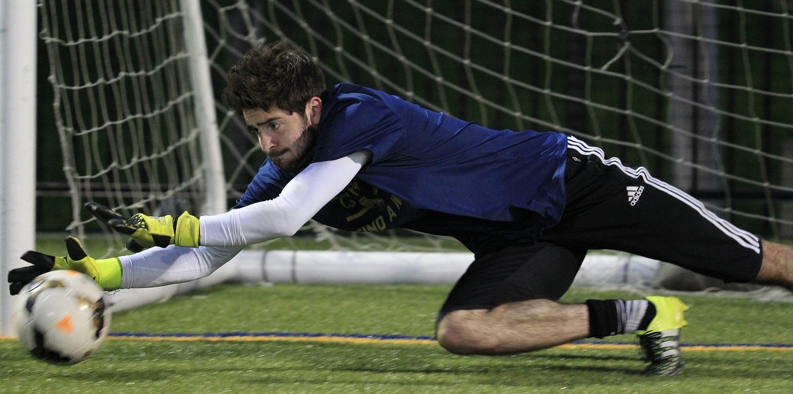 FC Buffalo goalkeeper Nick Jeffs dives to make a save during training. (Harry Scull Jr./Buffalo News)