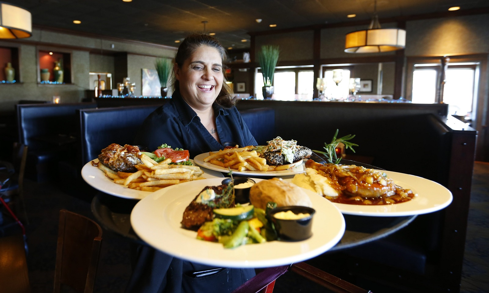 Kim Harvey serves some customers at the WaterStone Grill in Hamburg. (Mark Mulville/Buffalo News)