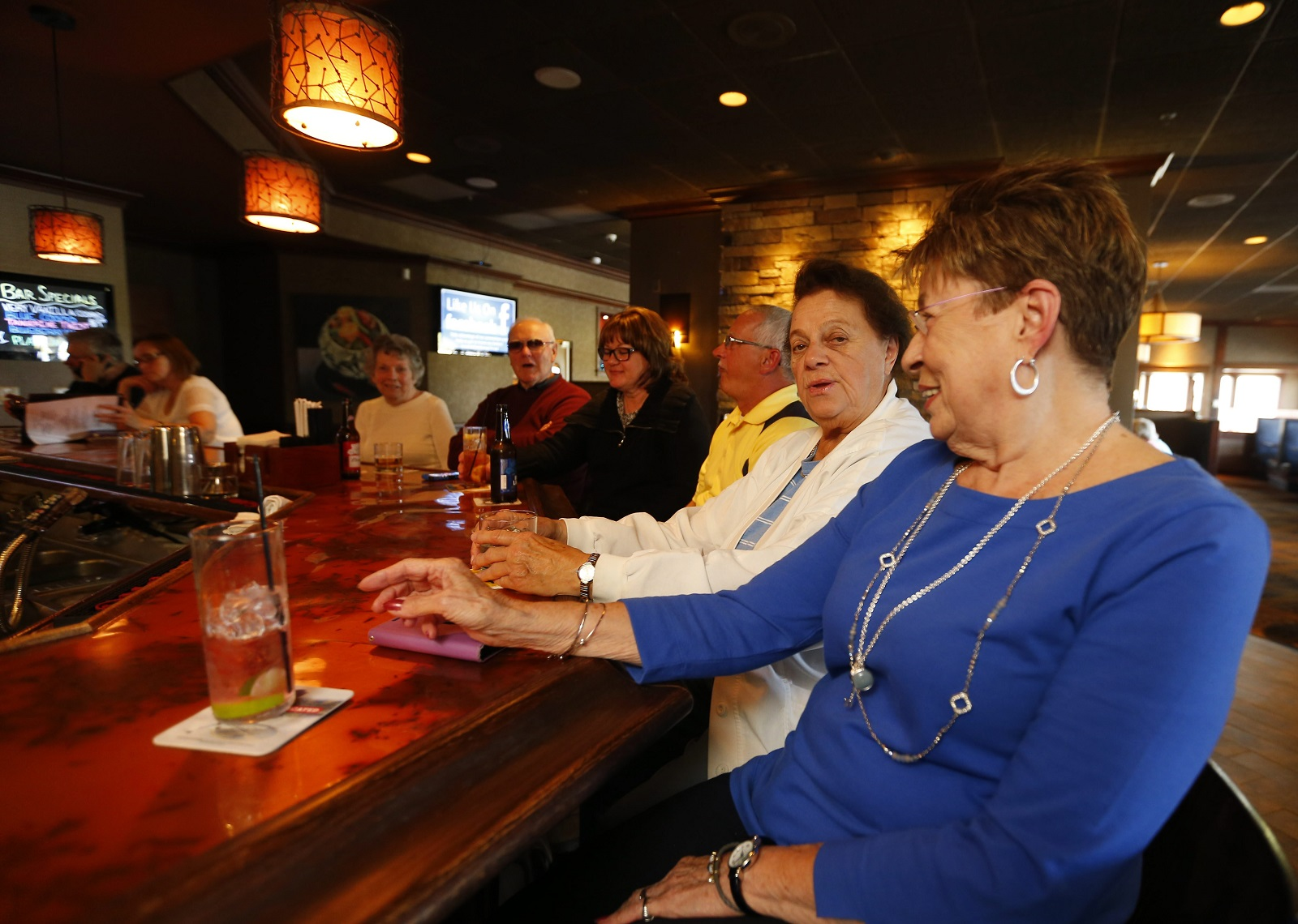 Customers enjoy a drink at the bar of the WaterStone Grill in Hamburg. (Mark Mulville/Buffalo News)