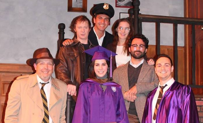 Niagara University graduate Kathleen Macari is surrounded by the cast of the Kavinoky Theatres 'Wait Until Dark' during a surprise graduation ceremony on May 14, 2016.