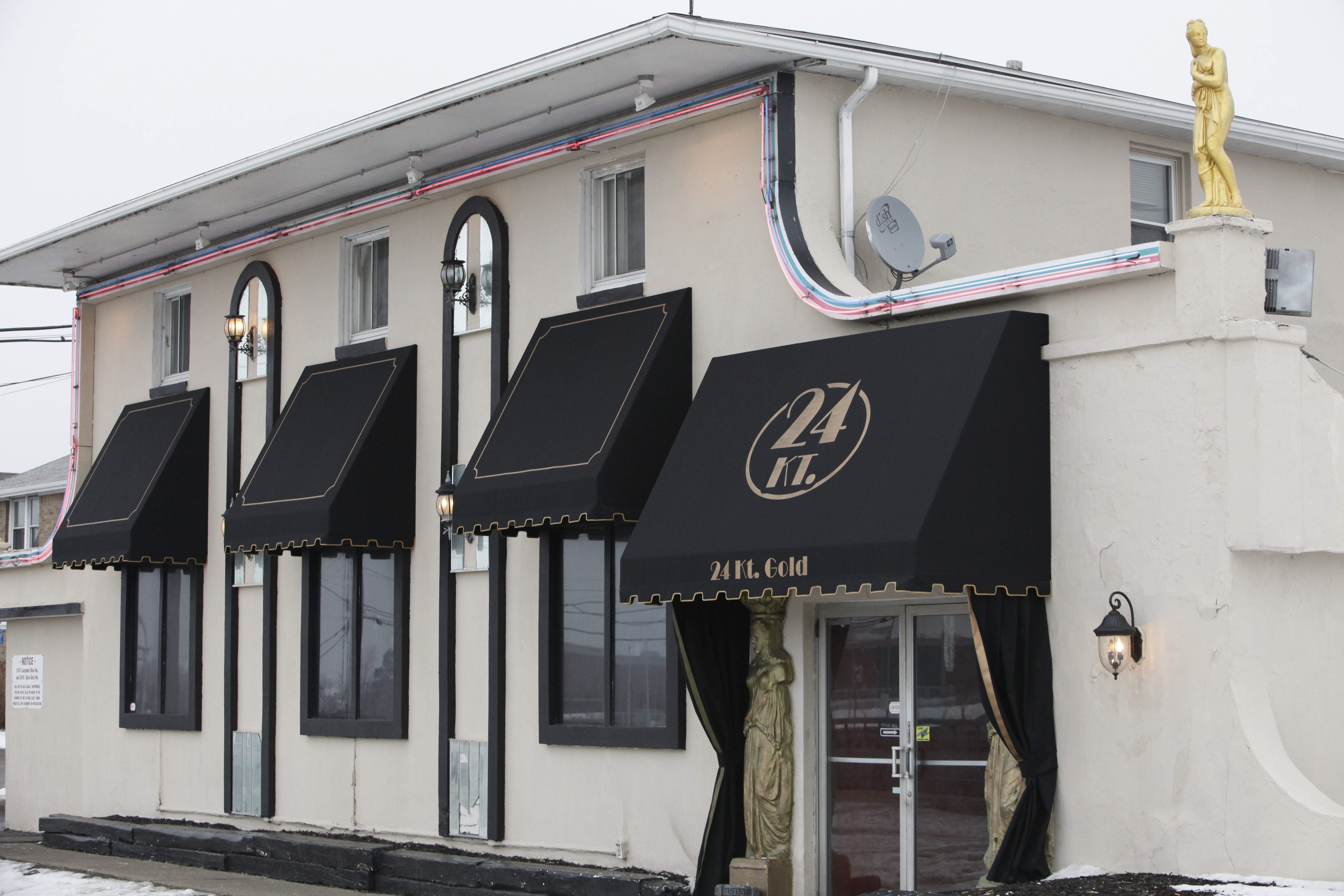 The Gold in Hamburg – formerly 24KT Gold, as seen in this News file photo – were padlocked closed Sunday morning. The landlords of that club and of Mademoiselle Gentlemen's Club in CHeektowaga said the club owners had not paid their rent in full in several years. (Derek Gee/News file photo)