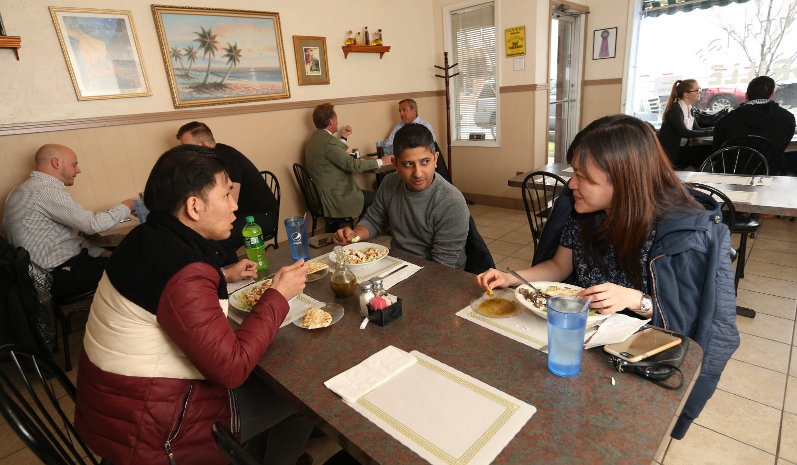 Having lunch at The Village Grille in Williamsville, from left, are Kevin Ng, Abhishek Ehoundiyal and Ann Tan. See a photo gallery at buffalonews.com. (Sharon Cantillon/Buffalo News)